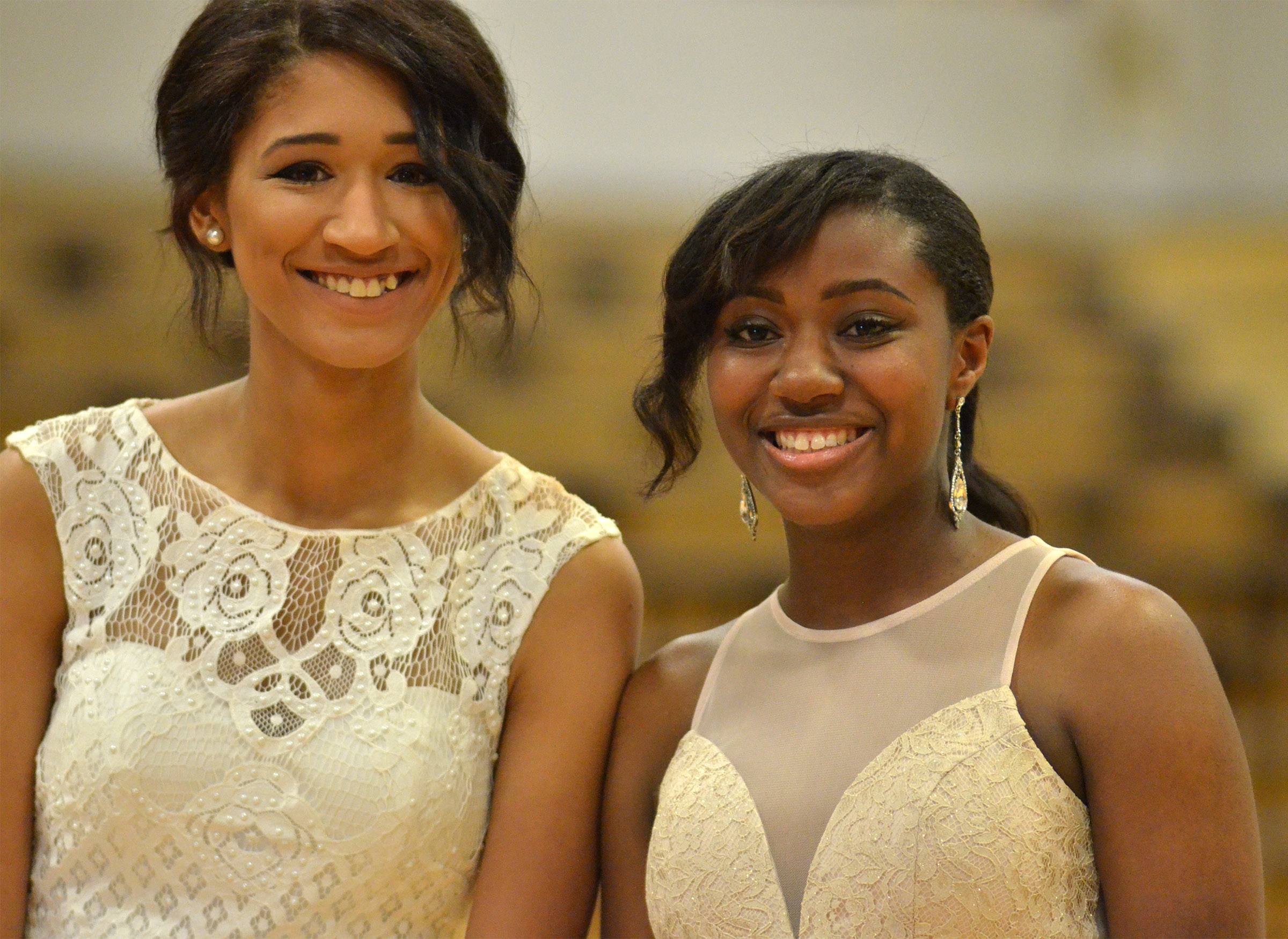 Lexi Shears, at left, and Latavia Shively smile as they walk into the gym.