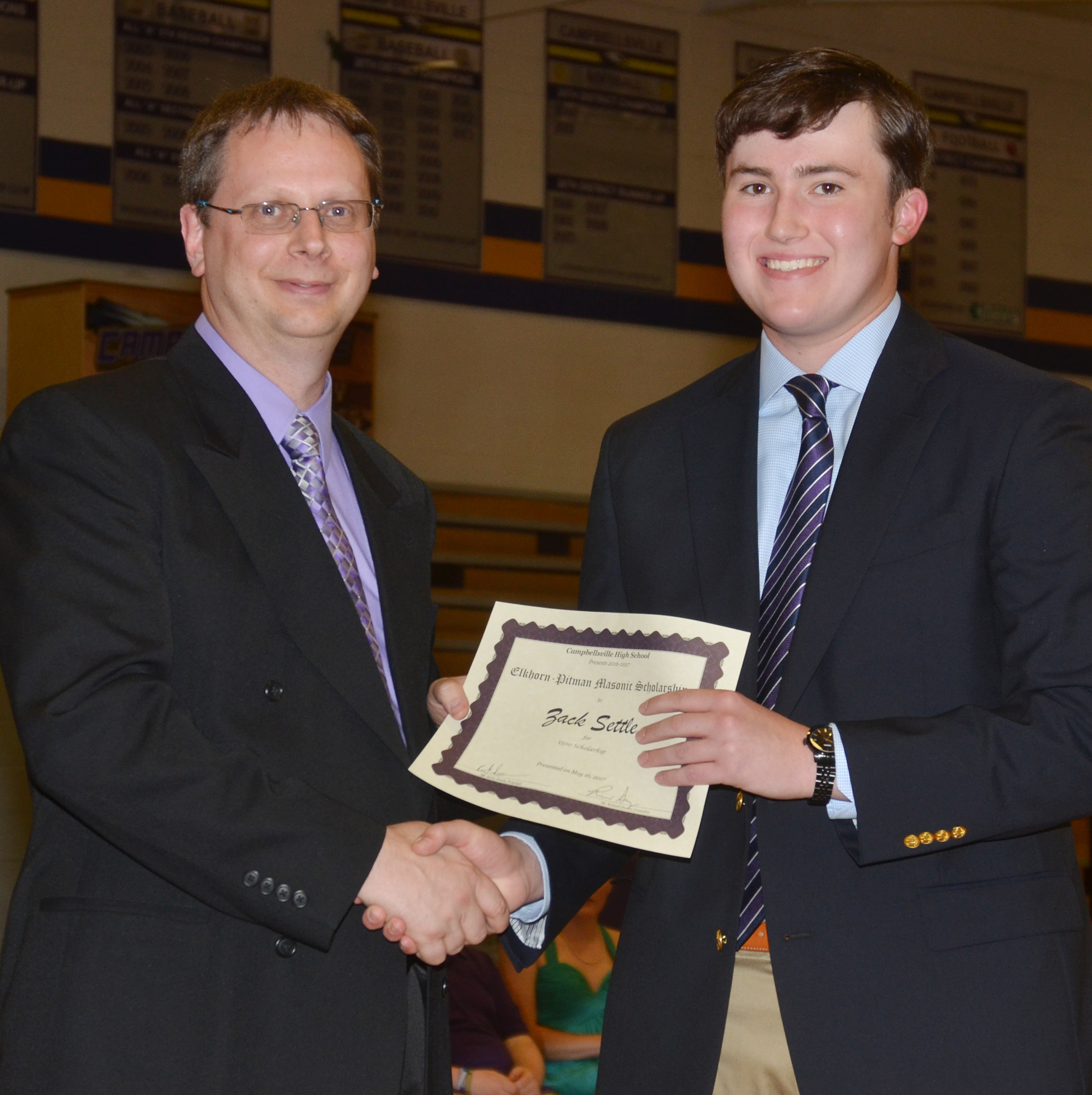Zack Settle receives the Elkhorn-Pittman Masonic Lodge scholarship. He is pictured with guidance counselor Richard Dooley.