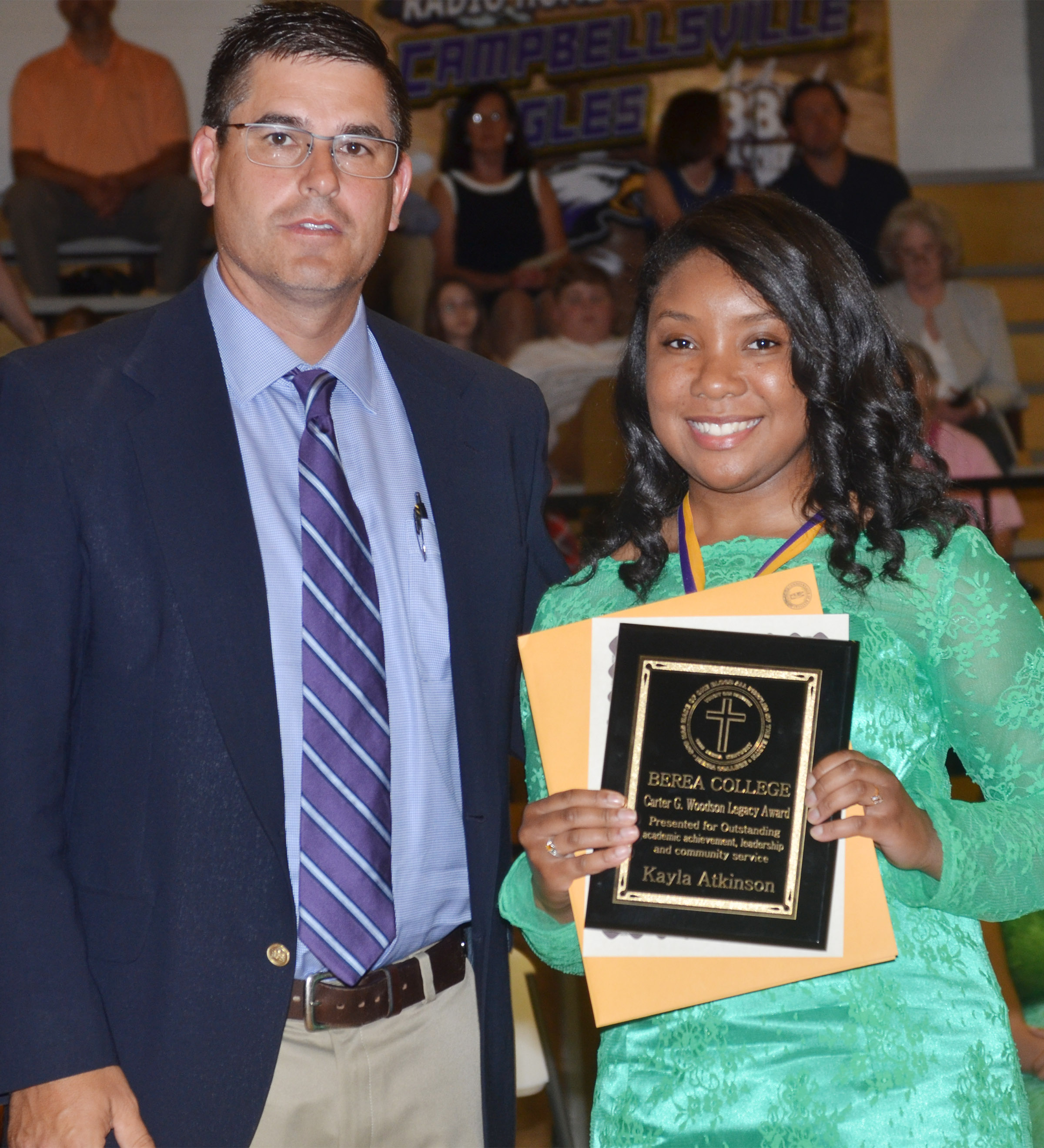 Kayla Atkinson receives the Berea College Carter G. Woodson Legacy Award. She is pictured with Principal Kirby Smith.