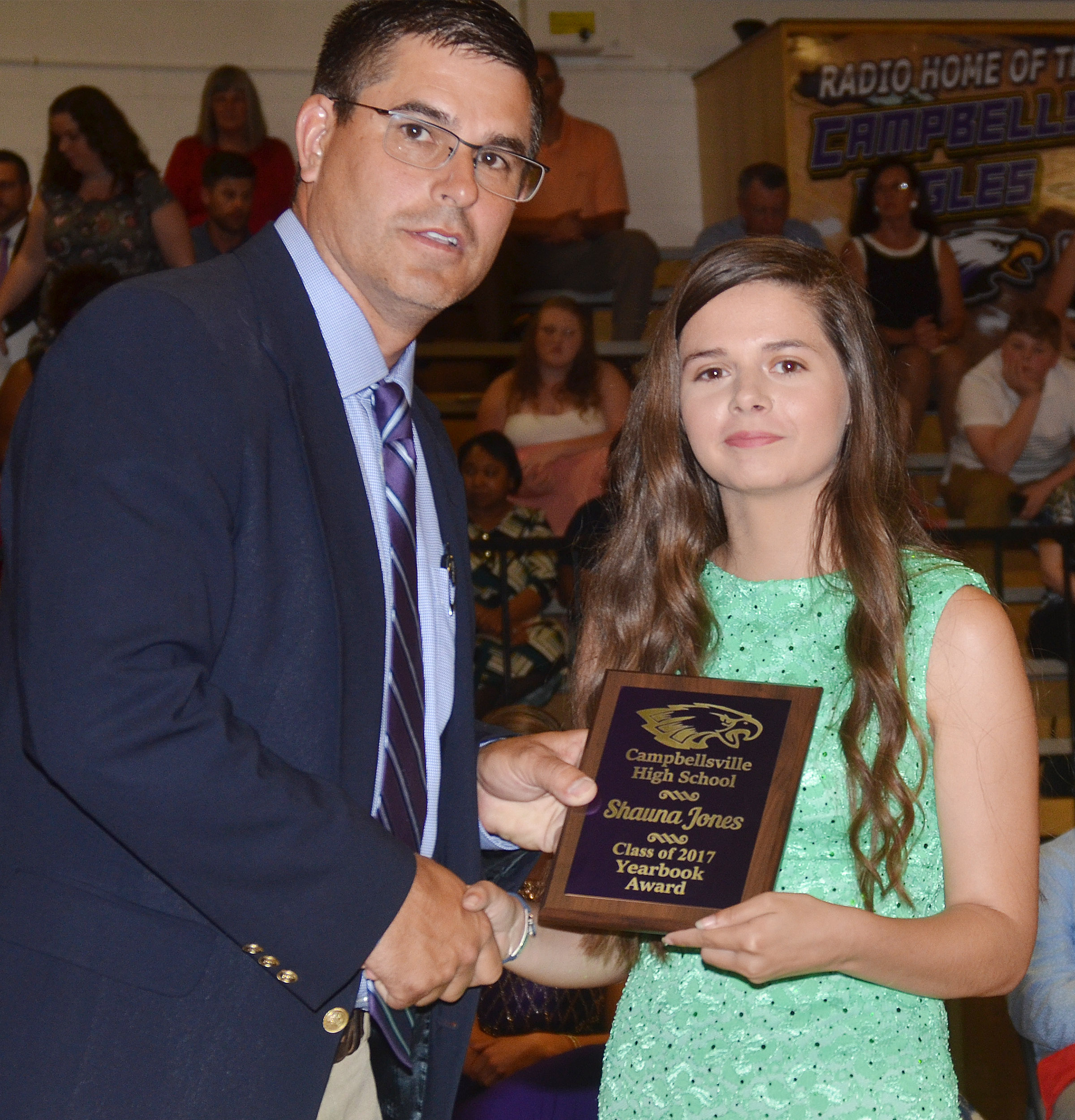 Shauna Jones receives the yearbook award. She is pictured with Principal Kirby Smith.