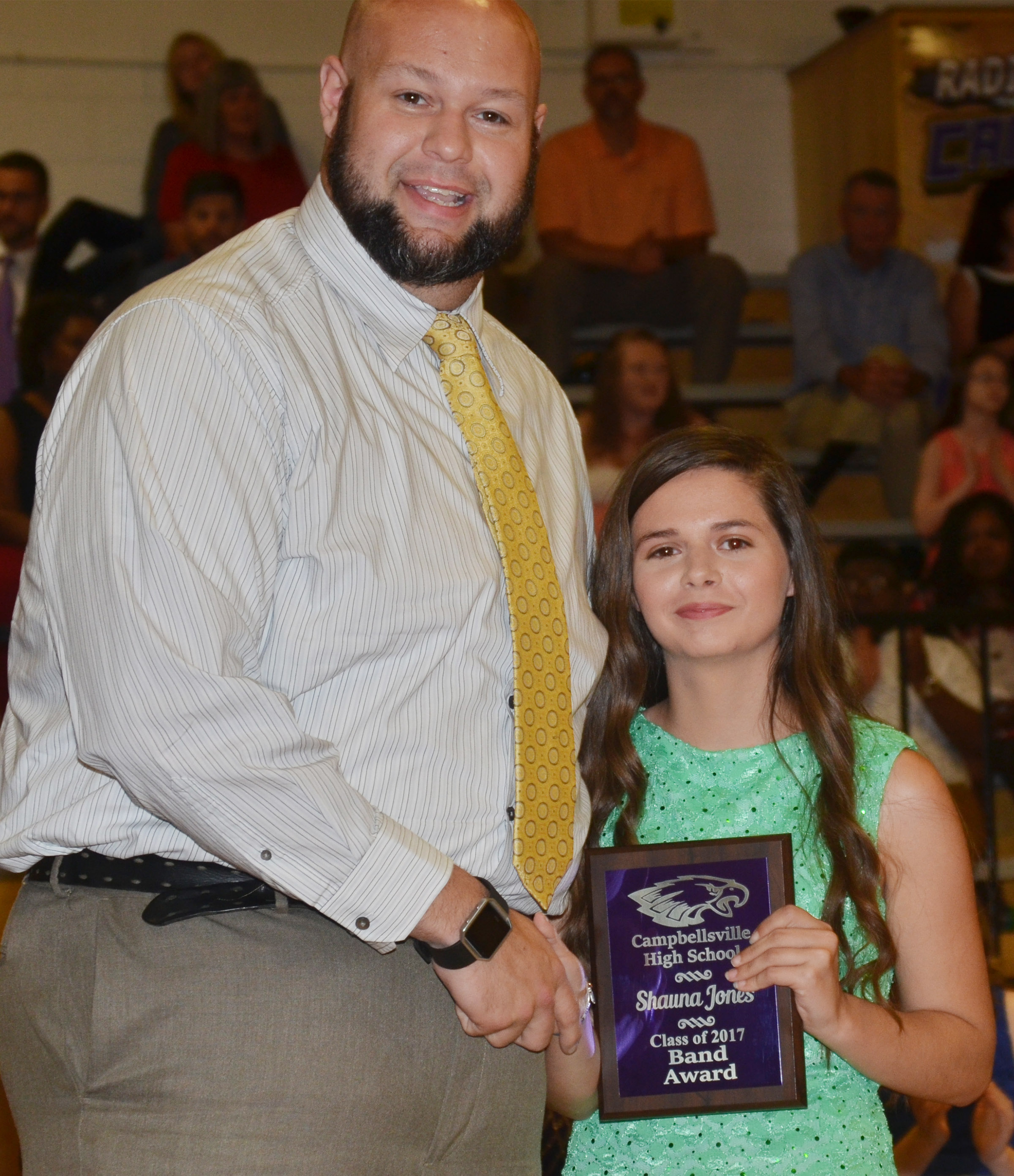 Shauna Jones receives the band award. She is pictured with band director Zach Shelton.