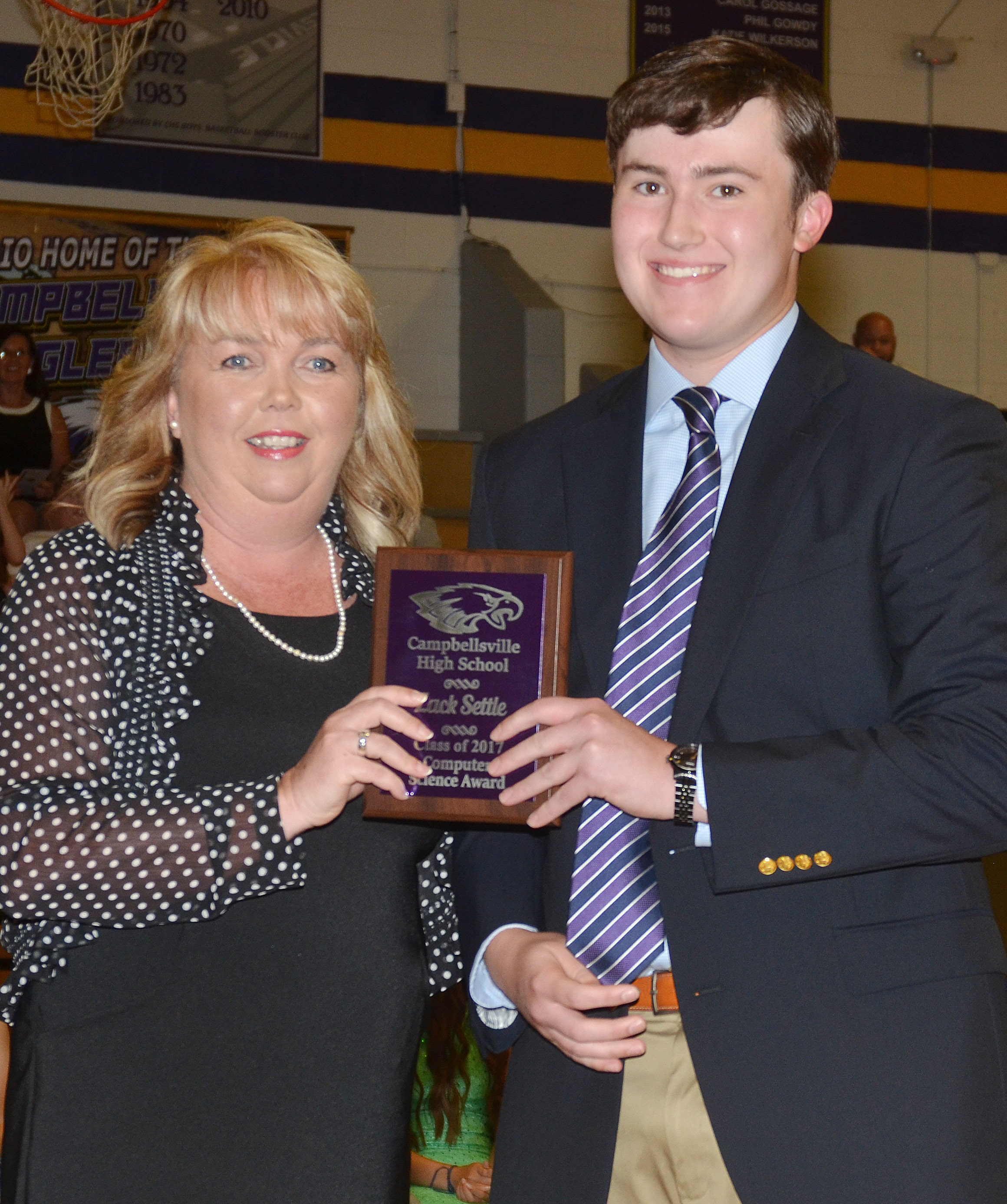 Zack Settle receives the computer science award. He is pictured with computer science teacher Sonya Kessler.