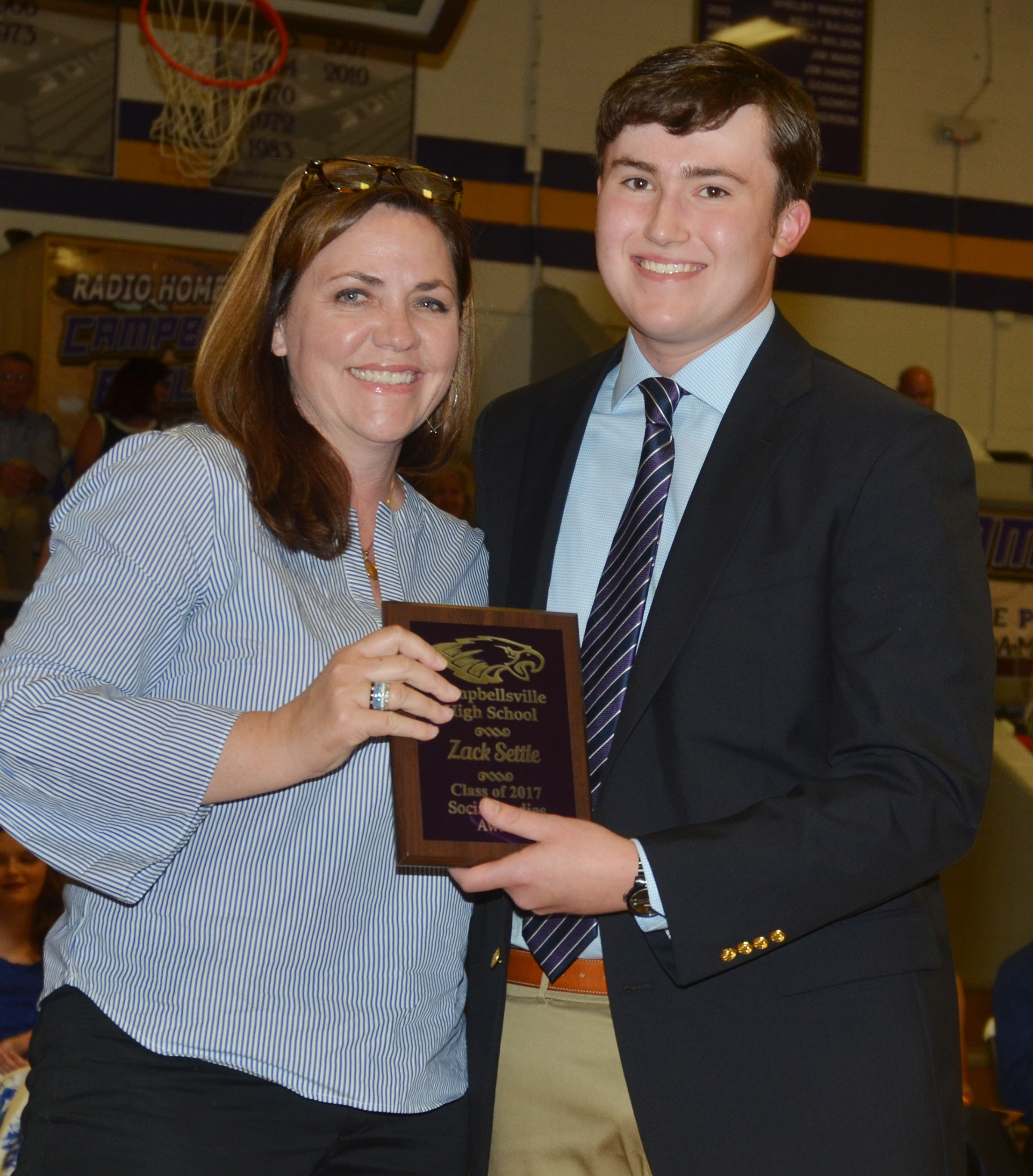 Zack Settle receives the social studies award. He is pictured with social studies teacher Susan Dabney.