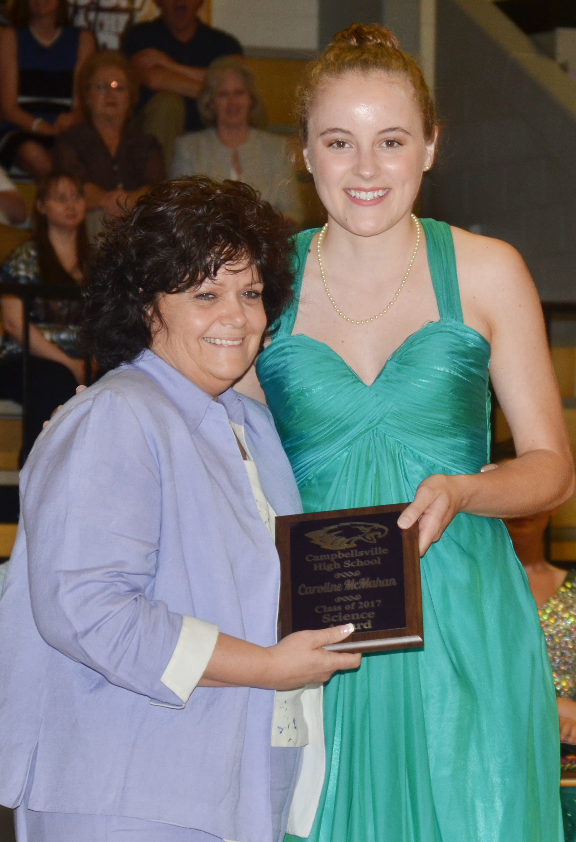Caroline McMahan receives the science award. She is pictured with science teacher Cheryl Dicken.