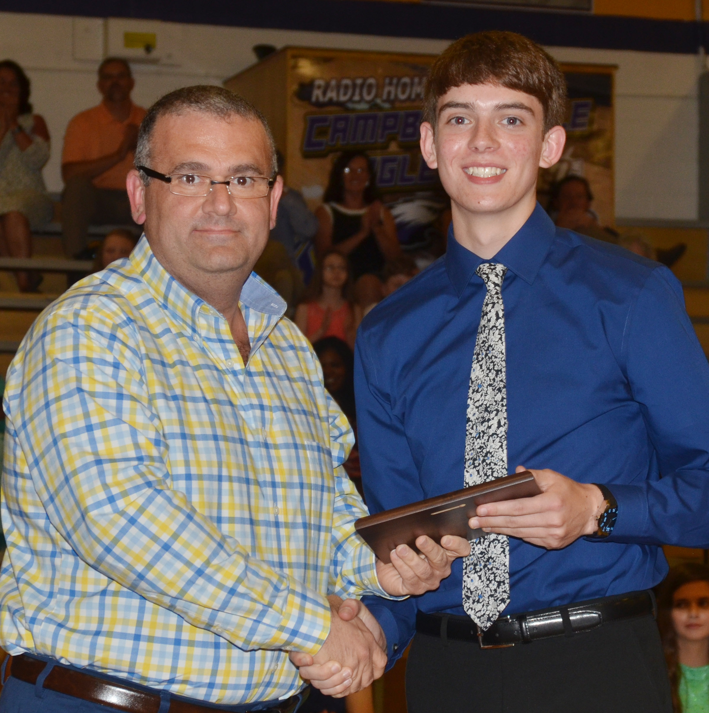 Murphy Lamb receives the math award. He is pictured with math teacher Kevin Rafferty.