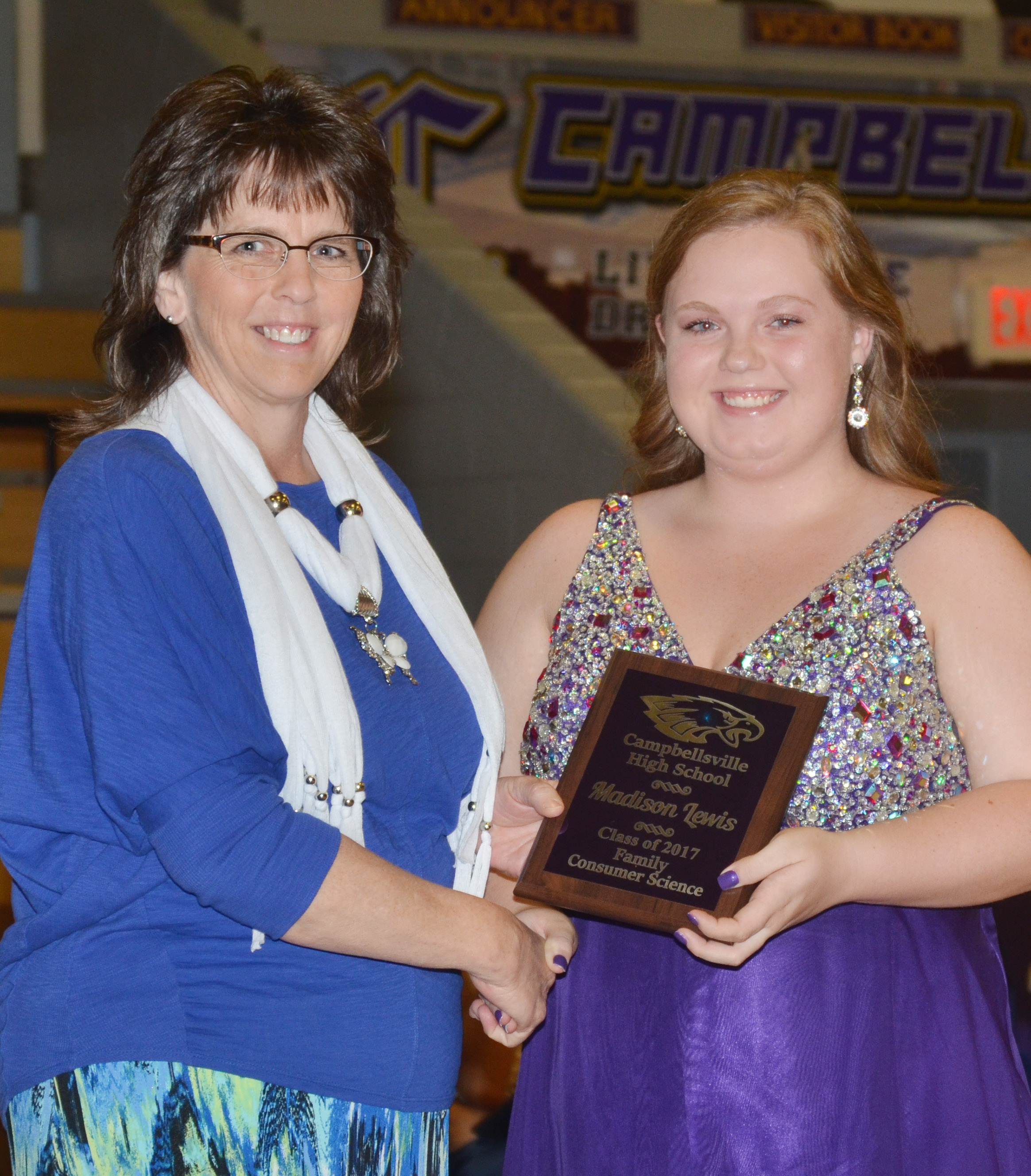 Madison Lewis receives the family consumer science award. She is pictured with family and consumer sciences teacher Deanna Campbell.