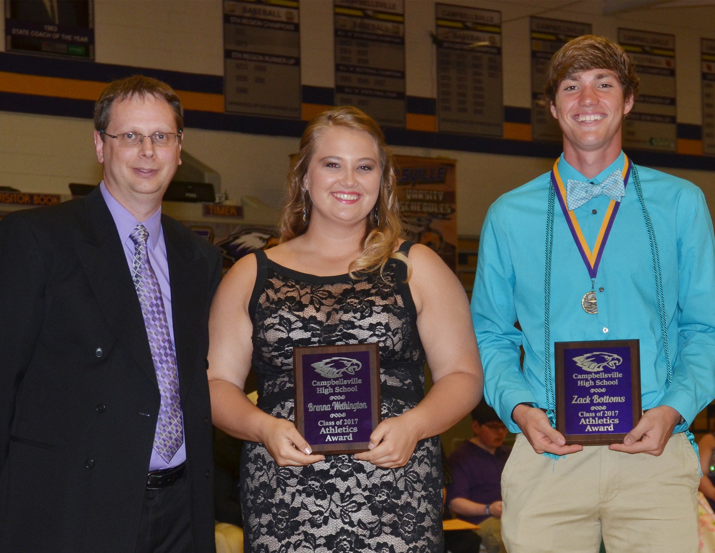 Brenna Wethington and Zack Bottoms receive the athletics award. They are pictured with guidance counselor Richard Dooley.
