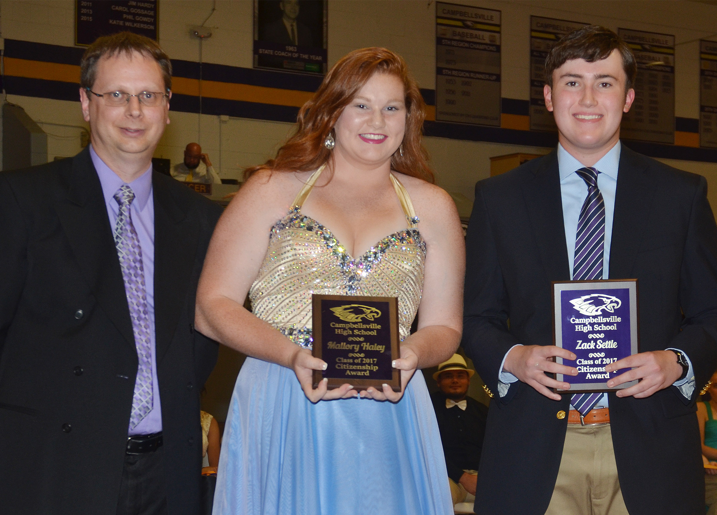 Mallory Haley and Zack Settle receive the citizenship award. They are pictured with guidance counselor Richard Dooley.
