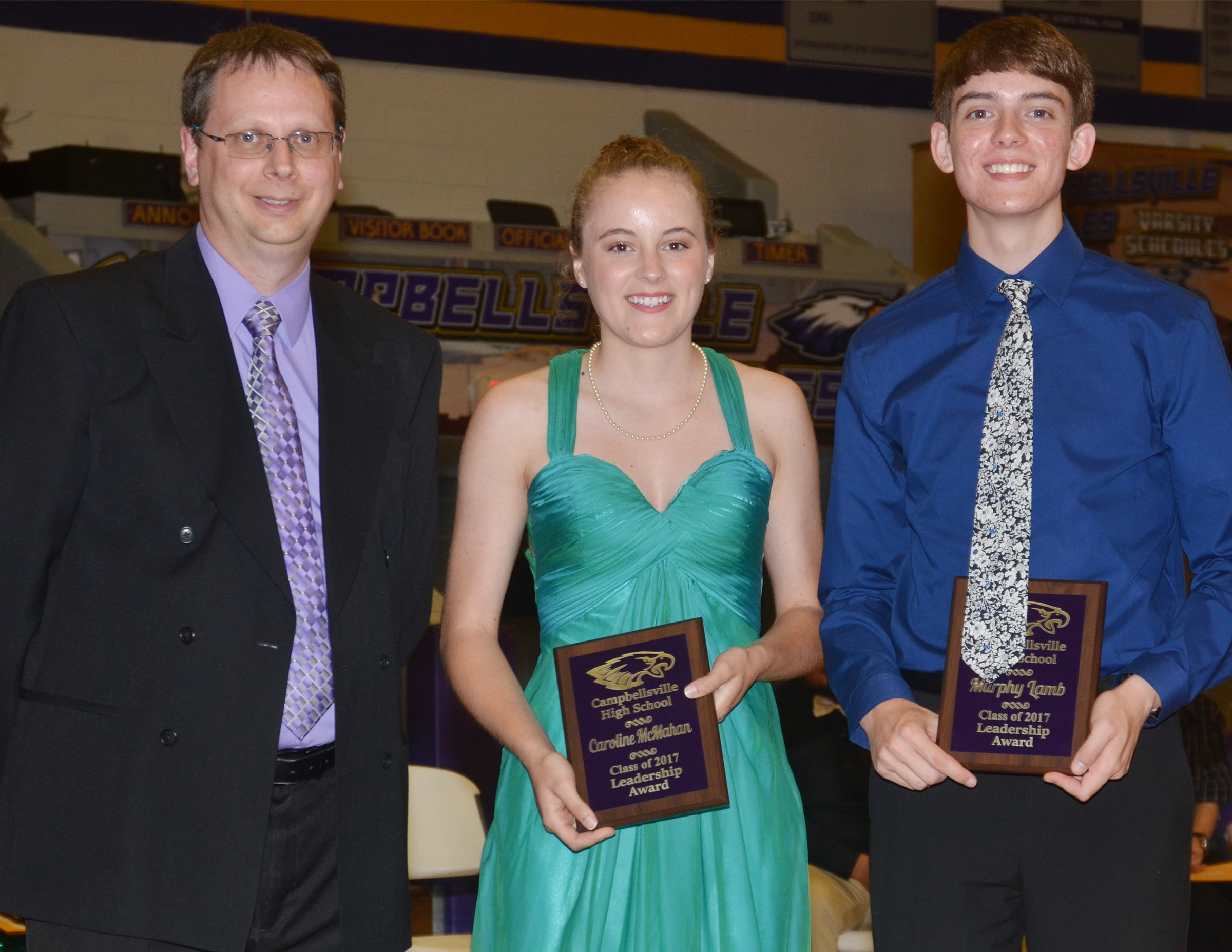 Caroline McMahan and Murphy Lamb receive the leadership award. They are pictured with guidance counselor Richard Dooley.