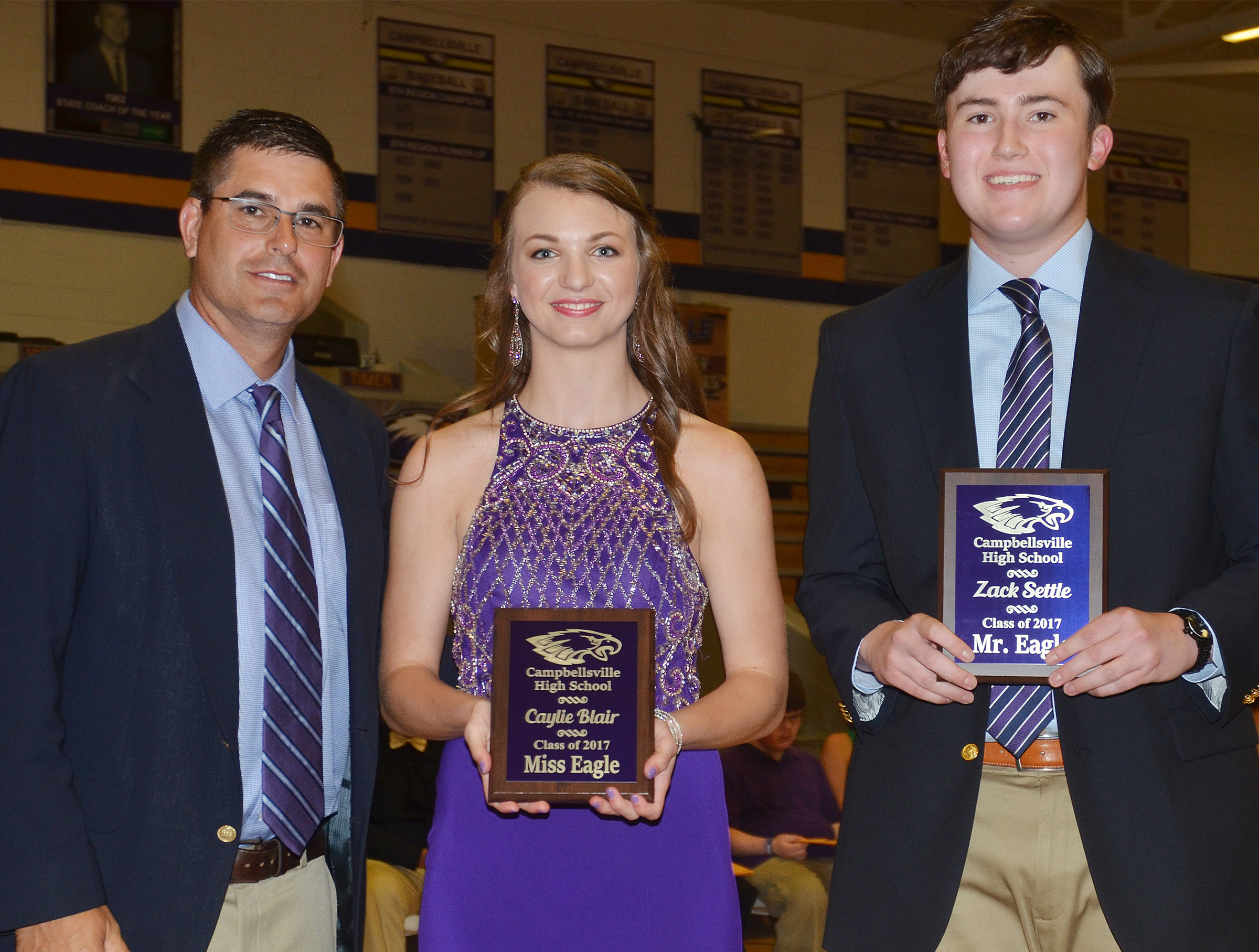 Caylie Blair receives the Miss Eagle award and Zack Settle receives the Mr. Eagle award. They are pictured with Principal Kirby Smith.
