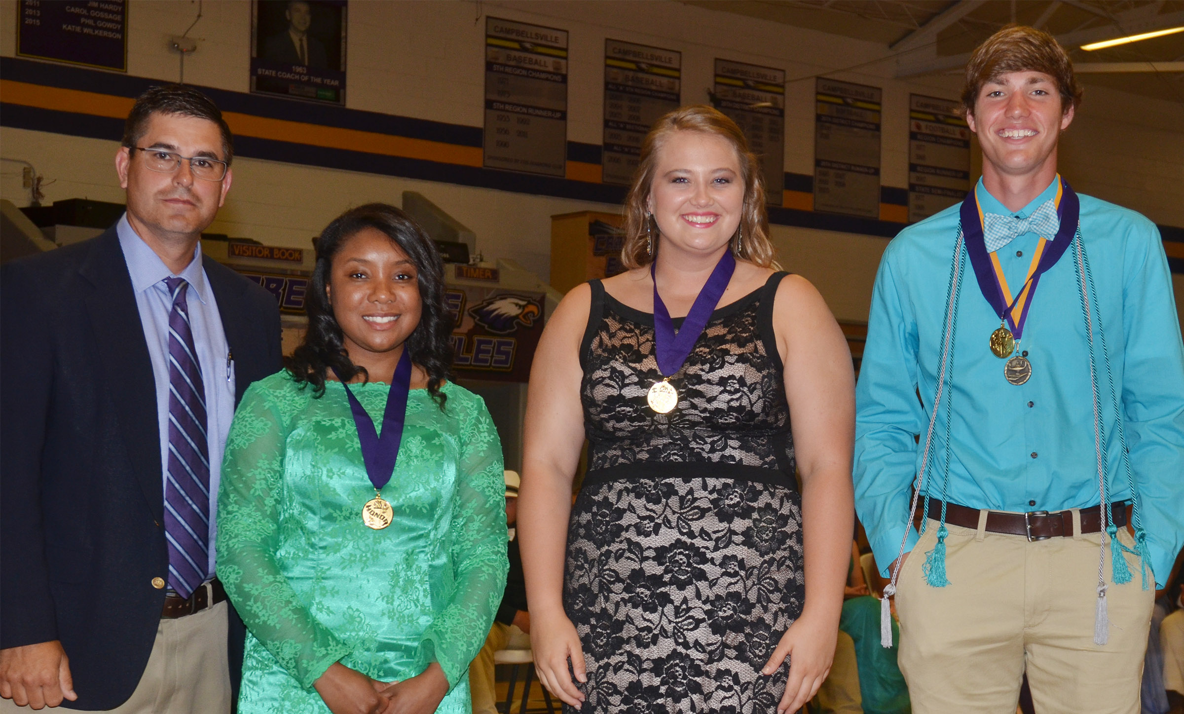 Receiving the Purple award for having GPAs between 3.5 and 3.7 are, from left, Principal Kirby Smith, Kayla Atkinson, Brenna Wethington and Zack Bottoms.