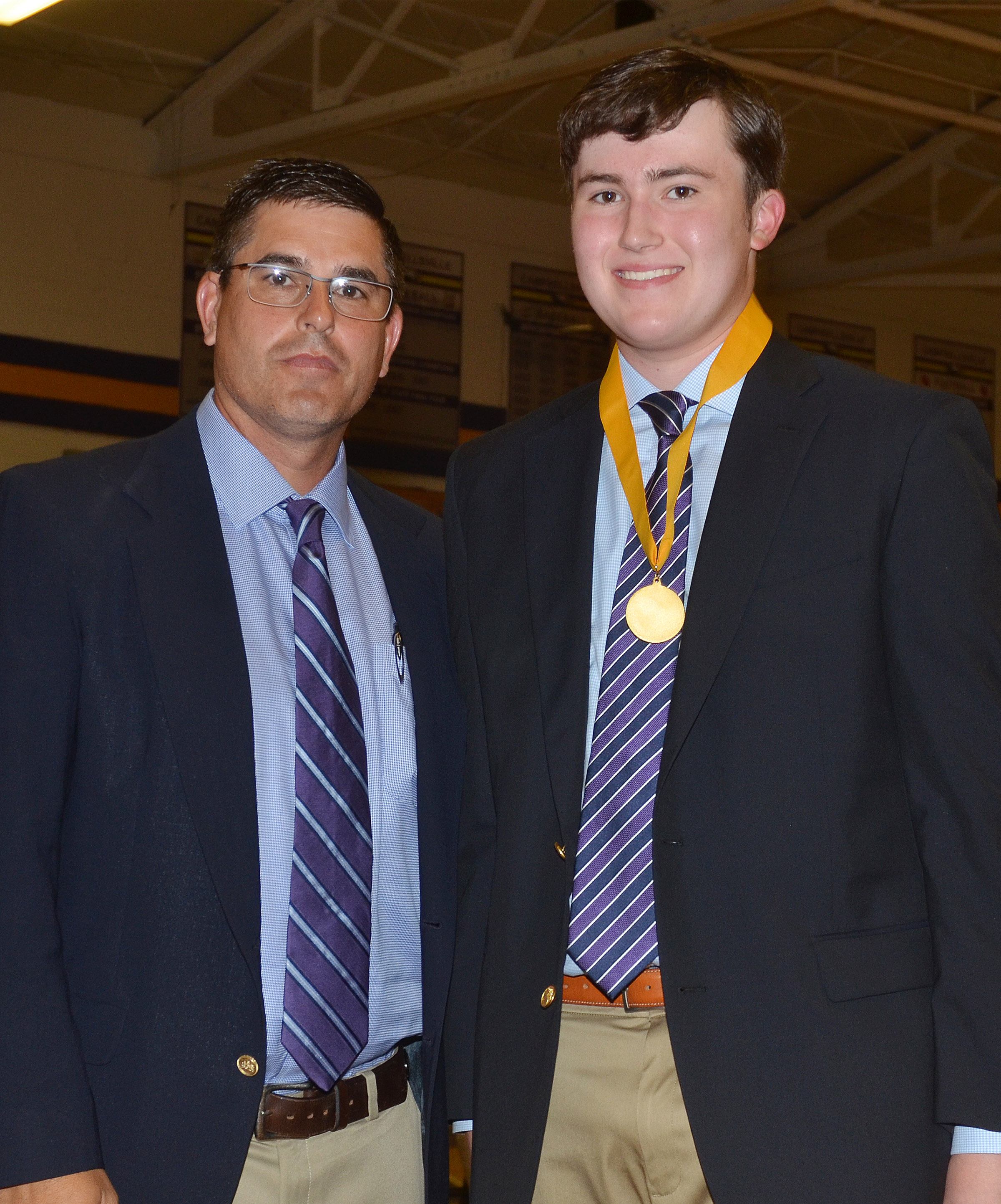 Zack Settle received the Gold award for having a GPA between 3.7 and 3.85. He is pictured with Principal Kirby Smith.