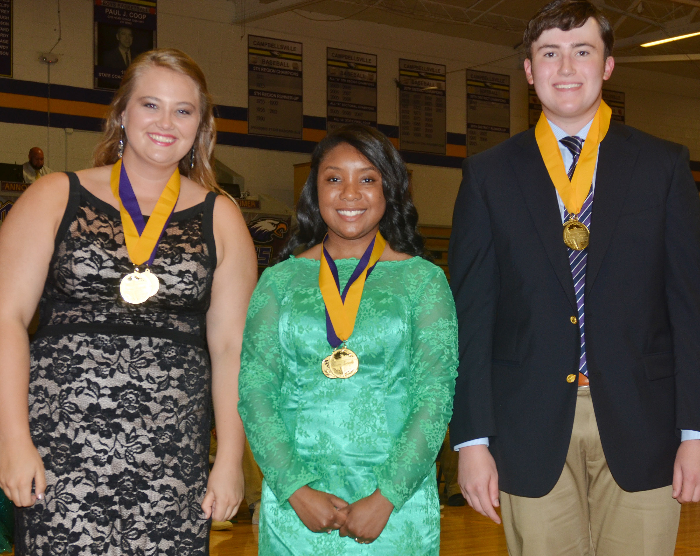 Receiving cum laude honors are, from left, Brenna Wethington, Kayla Atkinson and Zack Settle.