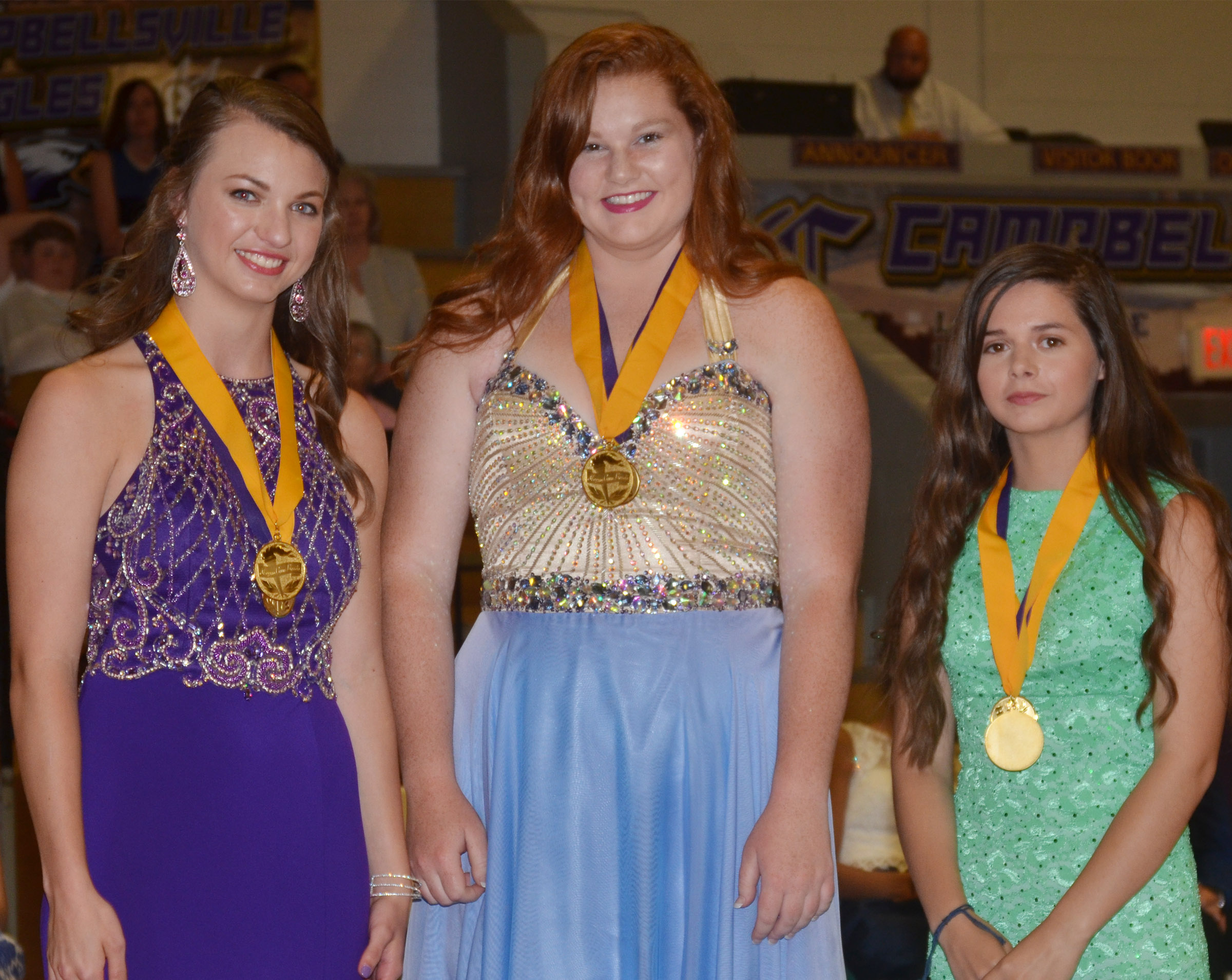 Receiving magna cum laude honors are, from left, Caylie Blair, Mallory Haley and Shauna Jones.