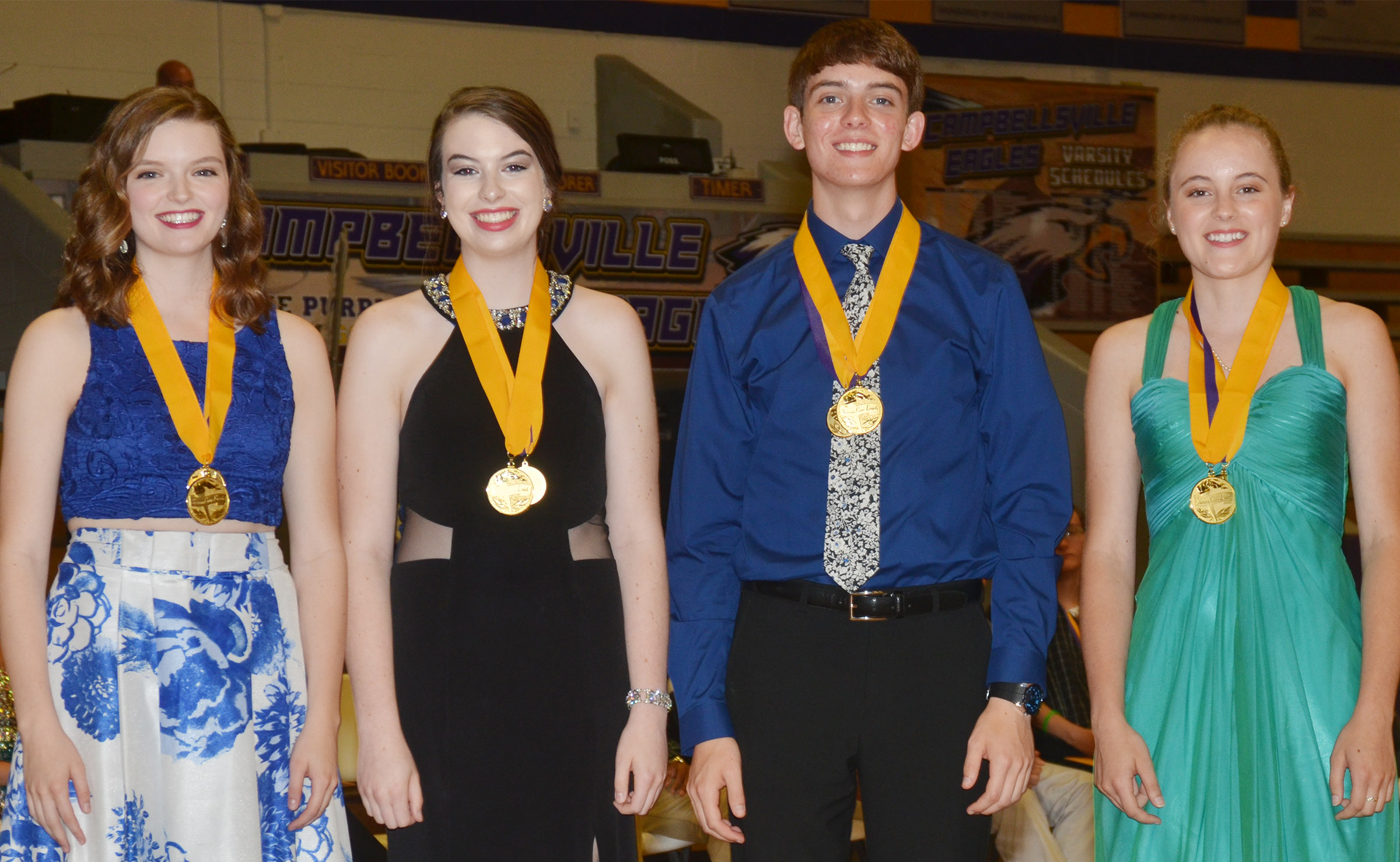 Receiving summa cum laude honors are, from left, Blair Lamb, Laura Lamb, Murphy Lamb and Caroline McMahan.