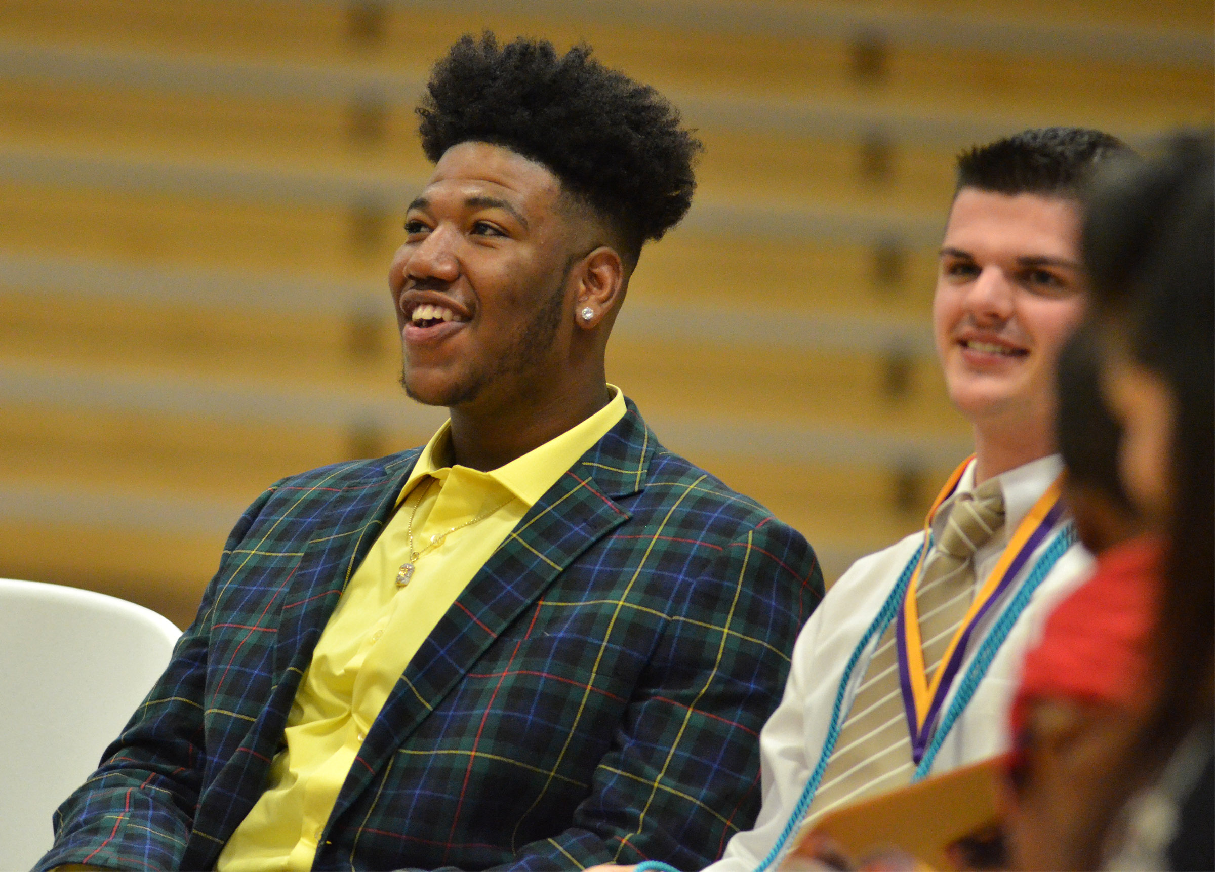 Micah Corley laughs as he and his classmates listen to their class history.