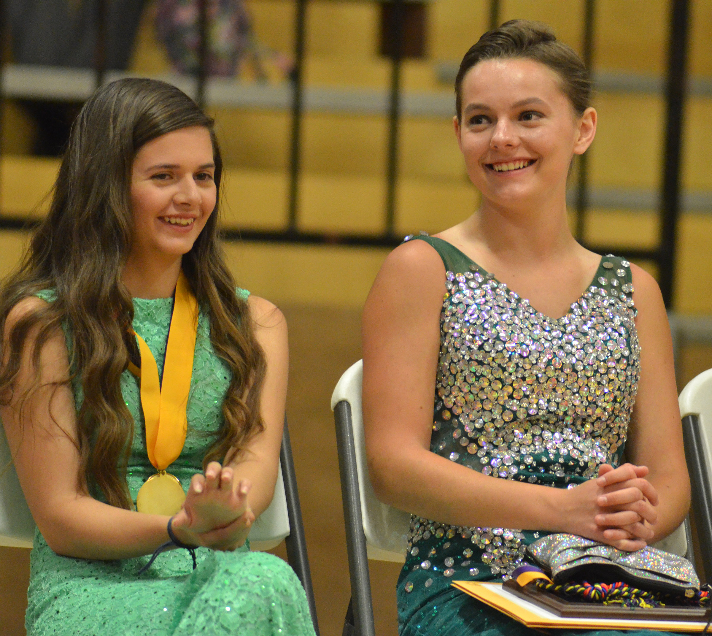 Shauna Jones, at left, and Kyrsten Hill laugh as they listen to the class history.