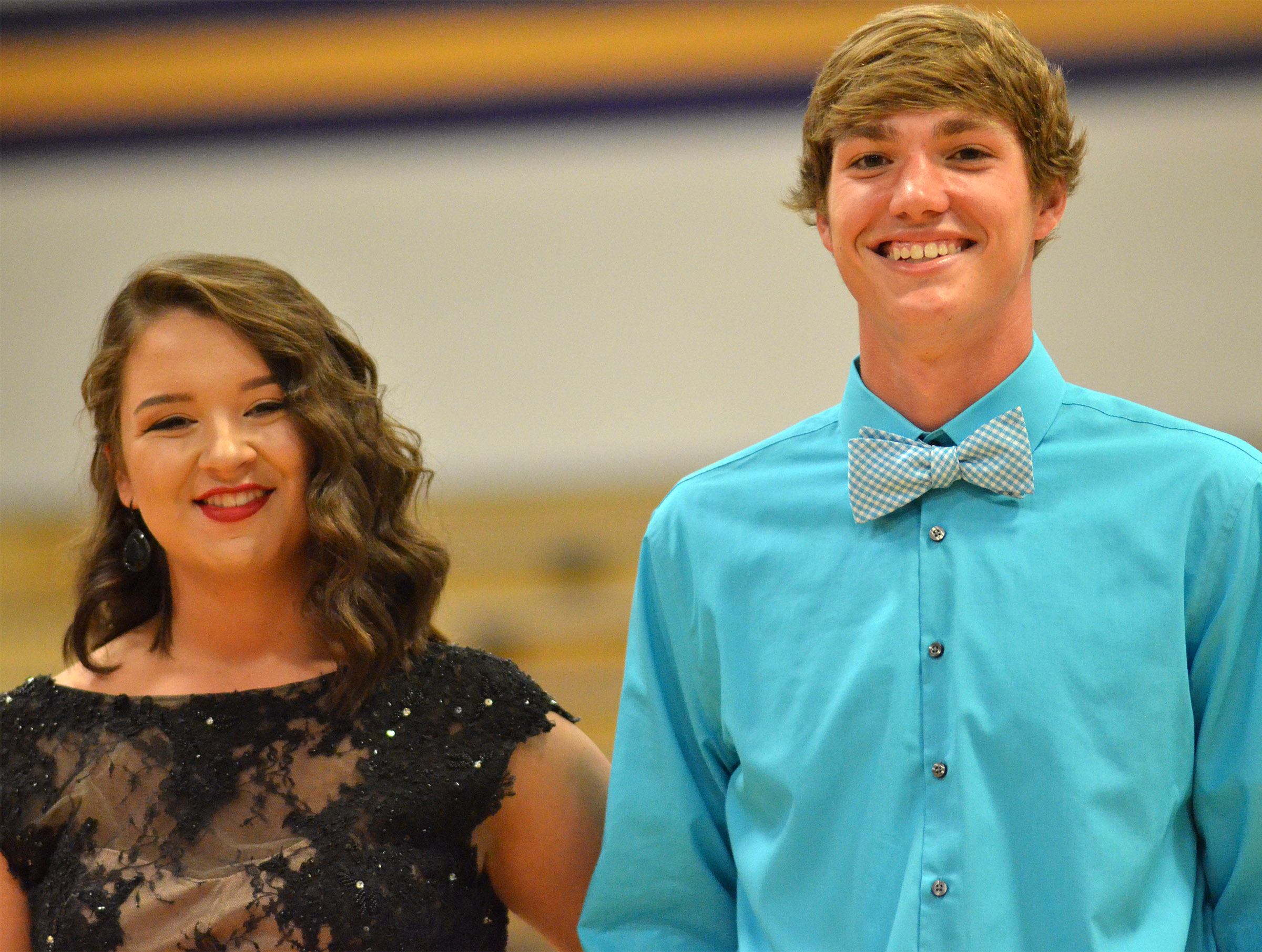 Kailey Morris, at left, and Zack Bottoms smile as they walk to their seats.