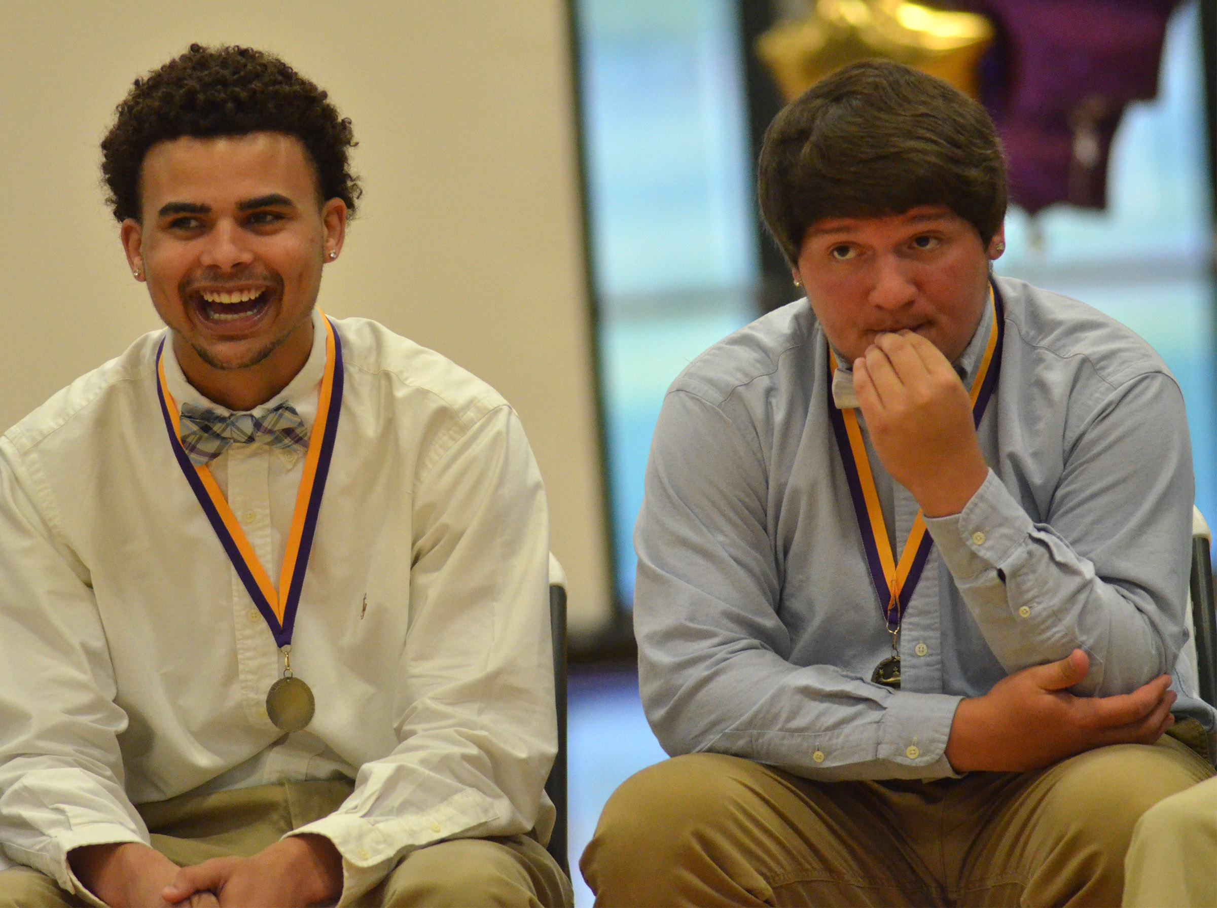 Arick Groves laughs as he and classmate Donnie Osinger listen to the class history.