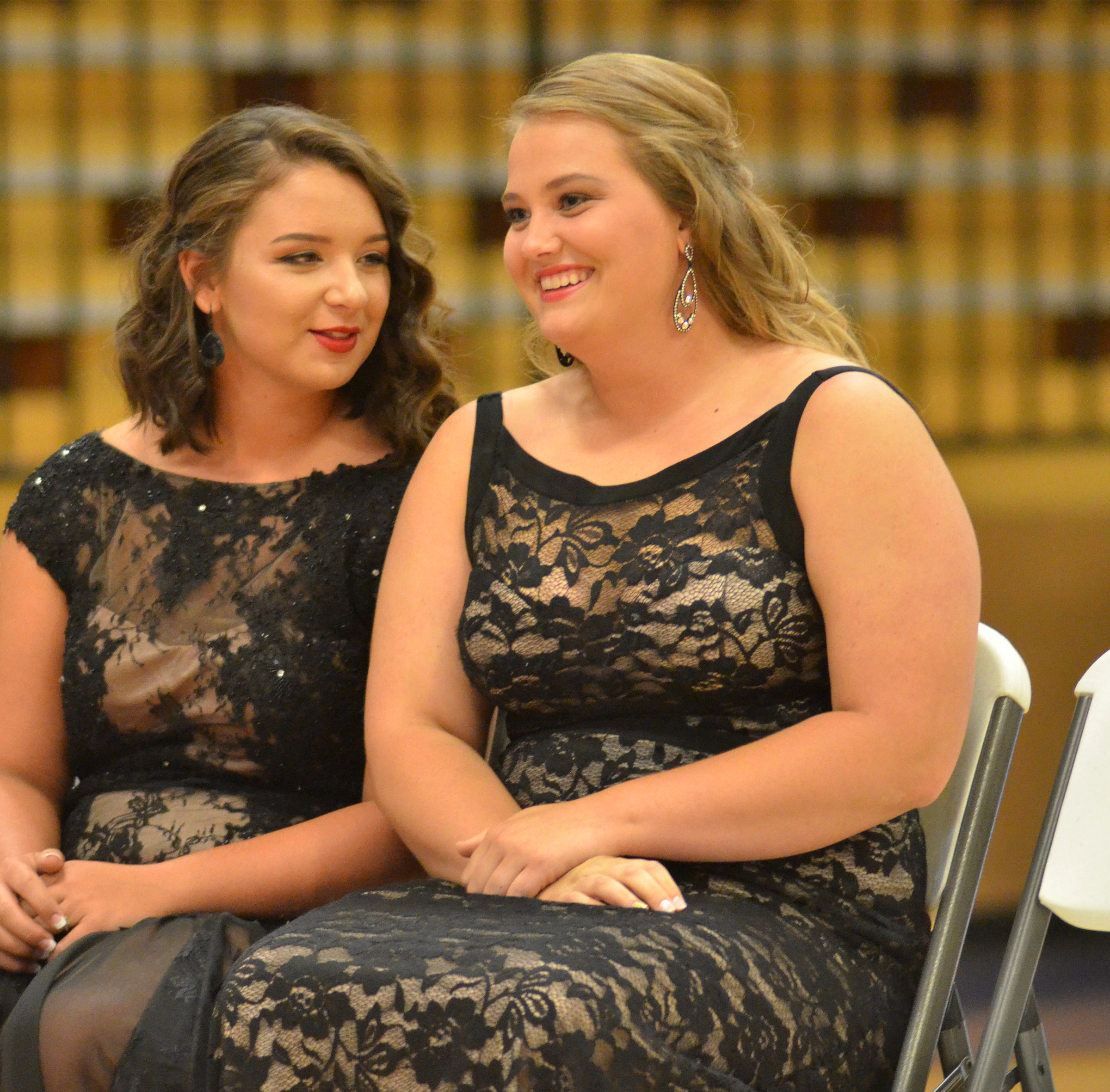 Kailey Morris, at left, and Brenna Wethington share a laugh during Class Night.