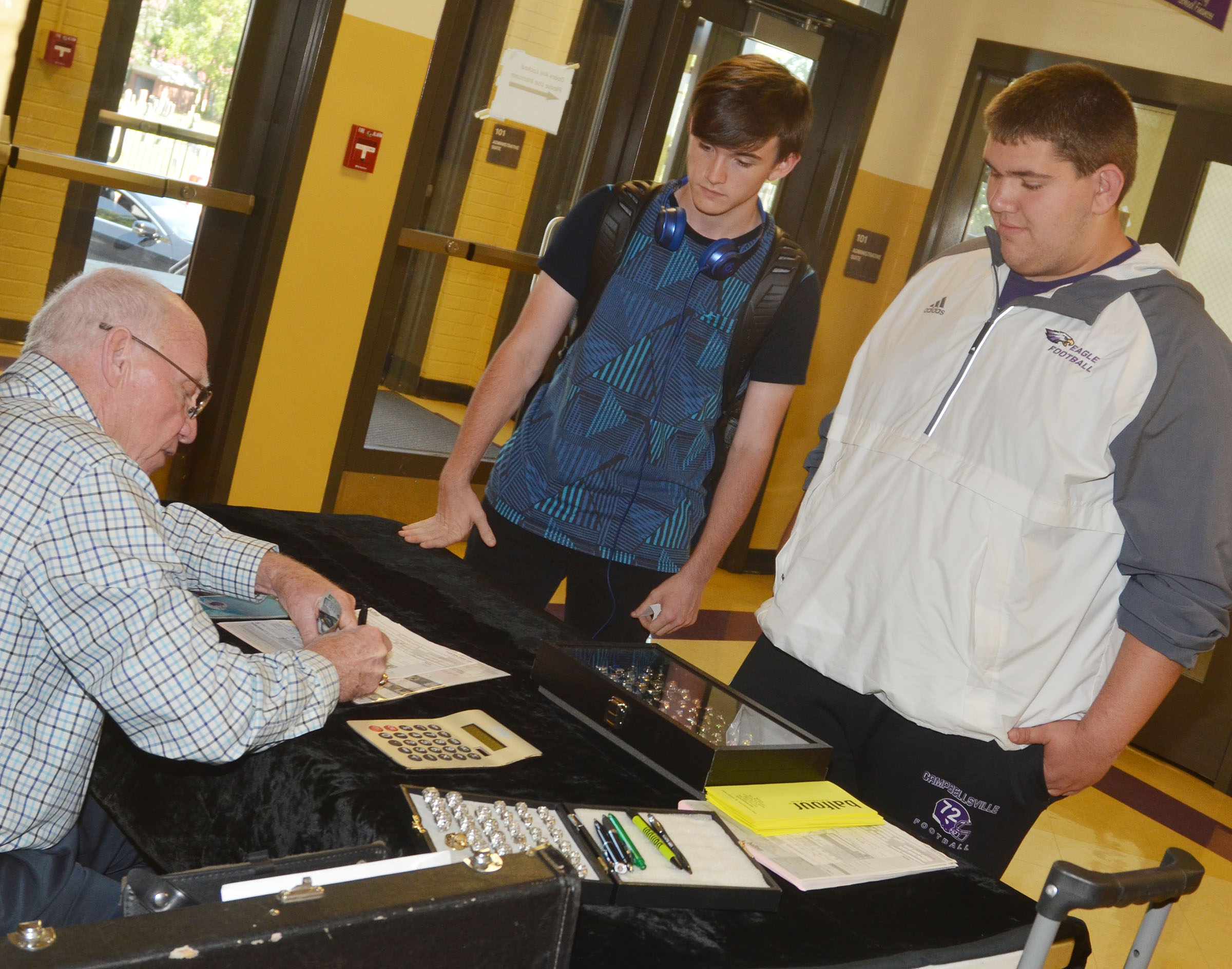 CHS juniors Jackson Hunt, at left, and Ryan Wiedewitsch submit their class ring orders.