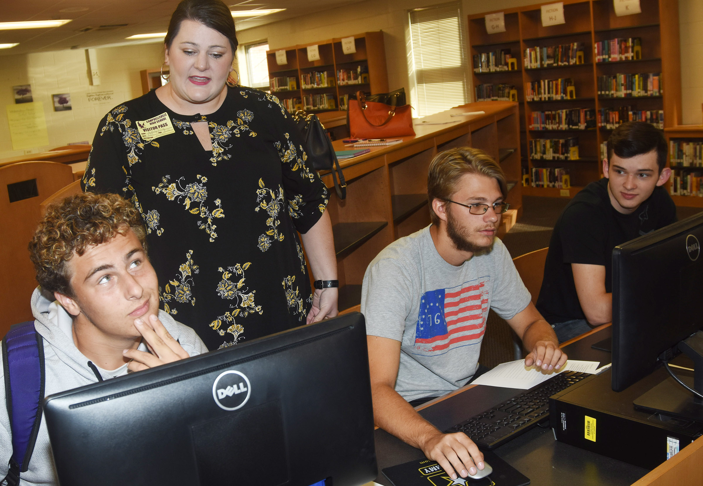 Audrey Price, southern Kentucky outreach counselor at Kentucky Higher Education Assistance Authority, helps CHS students, from left, Brody Weeks, Keidlan Boils and Cameron Bohannon as they apply to attend college.