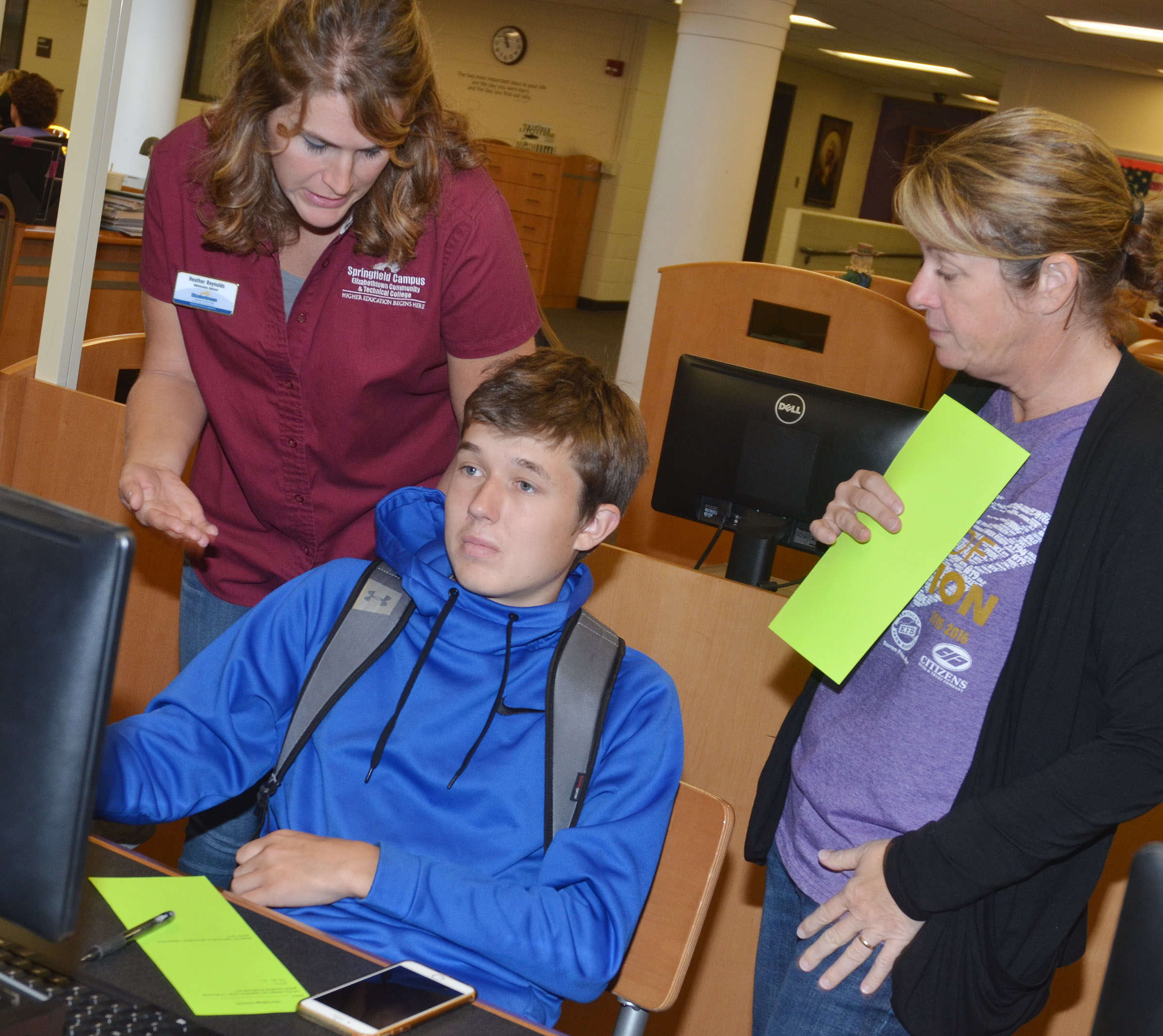 Heather Reynolds, admissions advisor at Elizabethtown Community & Technical College, at left, and CHS College and Career Readiness Counselor Dee Doss help senior Justin Humphress with a question about applying to attend college.