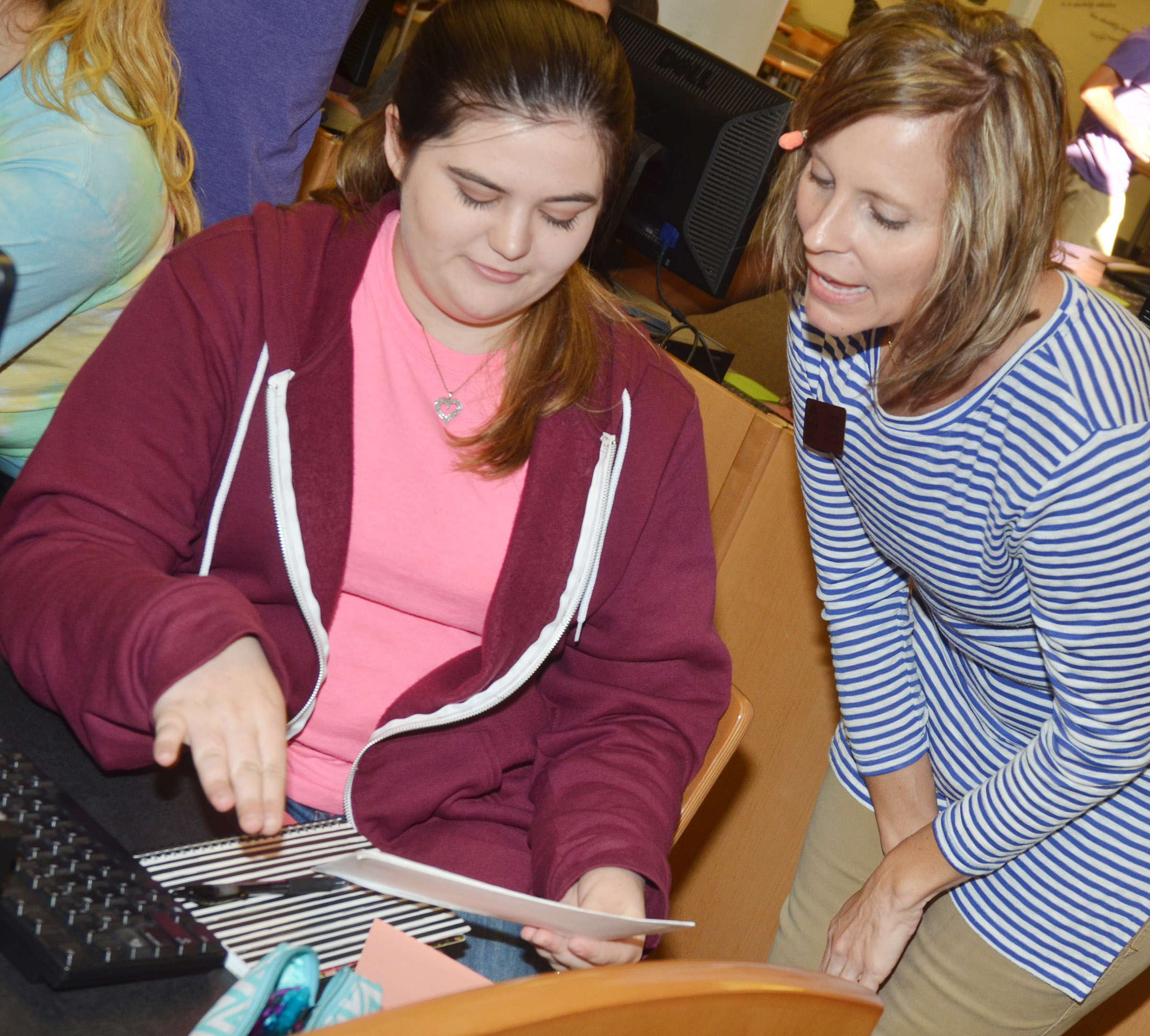 Charity Ferguson, director of admissions at Lindsey Wilson College, helps CHS senior Vivian Brown with a financial aid question.
