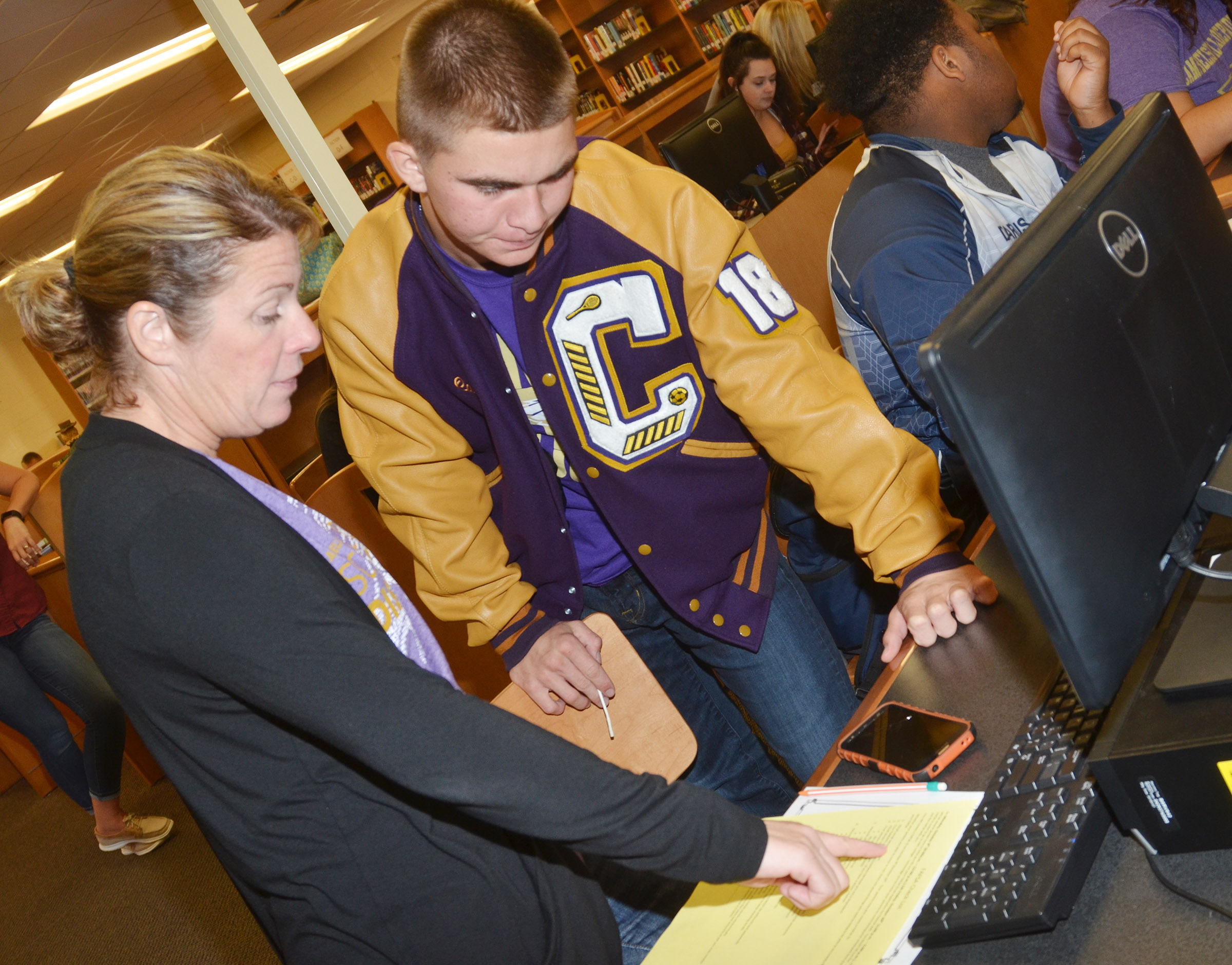 CHS College and Career Readiness Counselor Dee Doss helps senior Cass Kidwell with the steps required to apply to attend college.