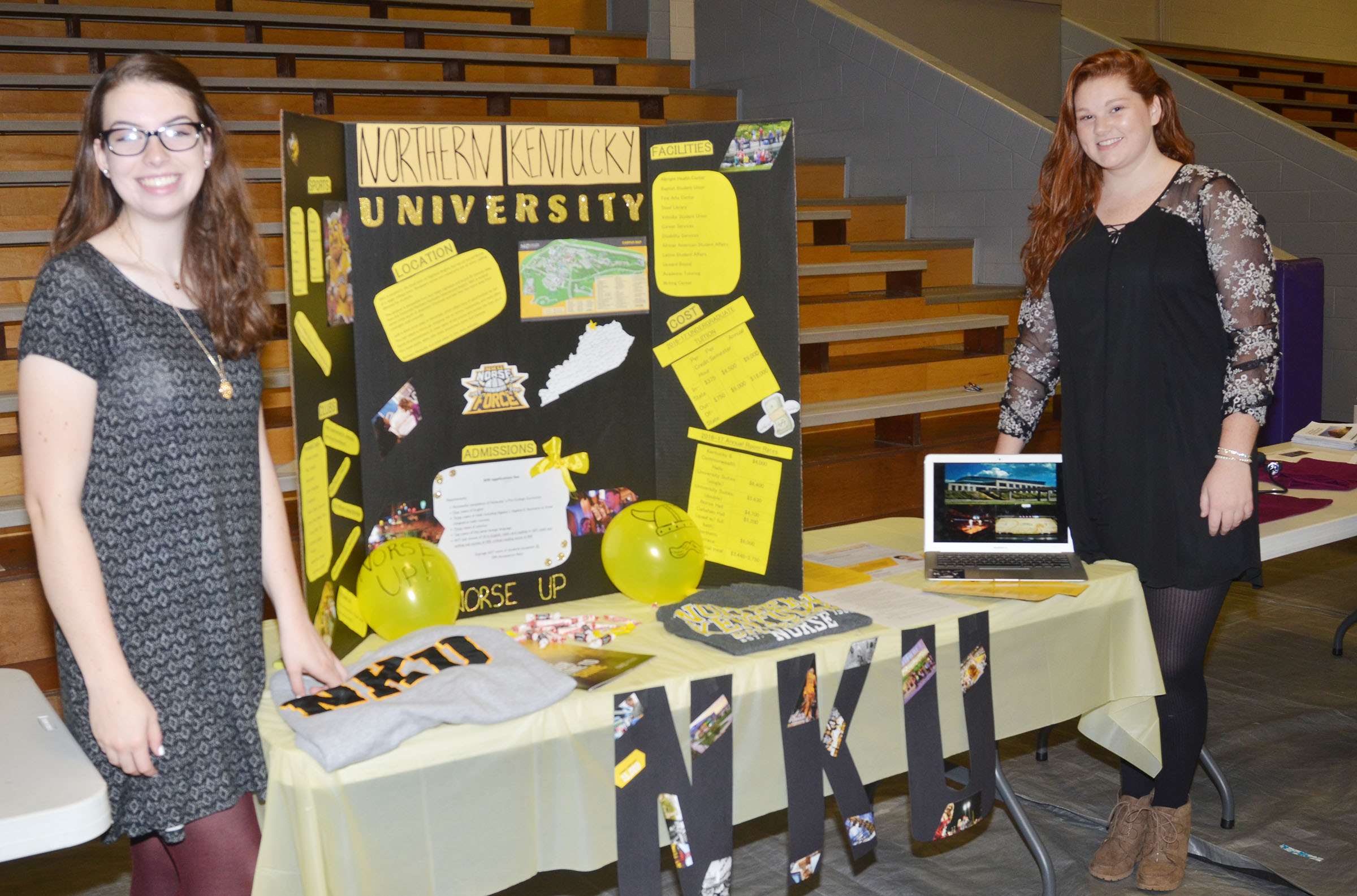CHS seniors Laura Lamb, at left, and Mallory Haley present information about Northern Kentucky University.