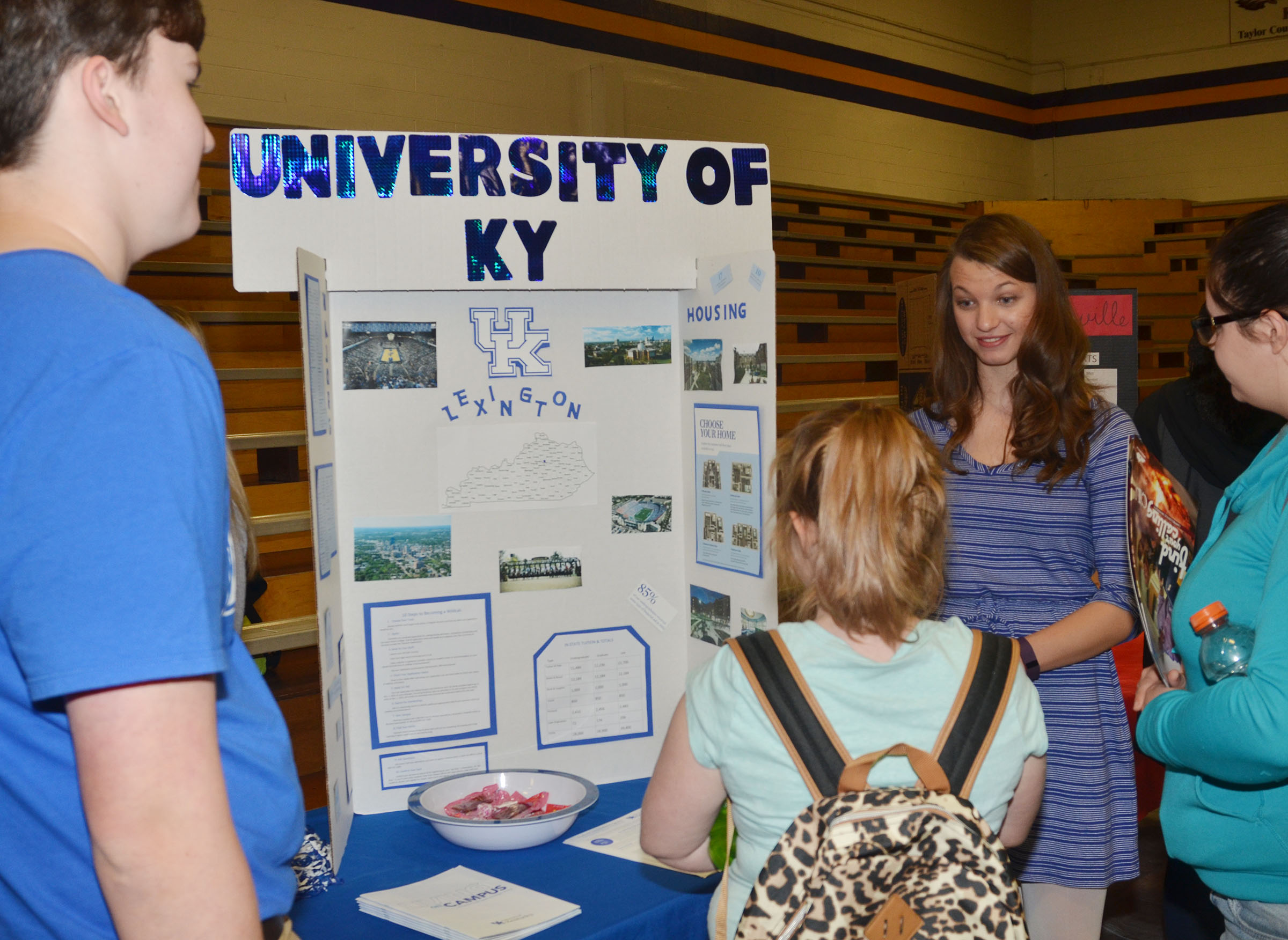CHS seniors Zack Settle, at left, and Caylie Blair present information about University of Kentucky.