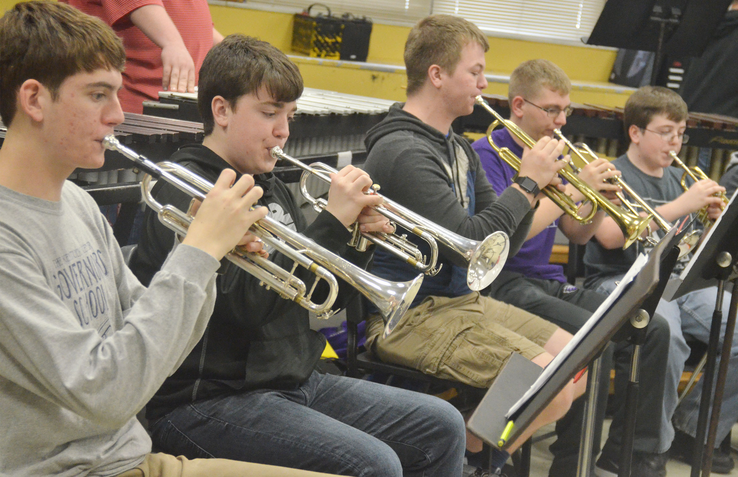 "CHS trumpet players, from left, senior Murphy Lamb, freshman Grant Rinehart, sophomores Josh Dooley and Brandon Greer and freshman Gavin Ford practice ""Arrows."""