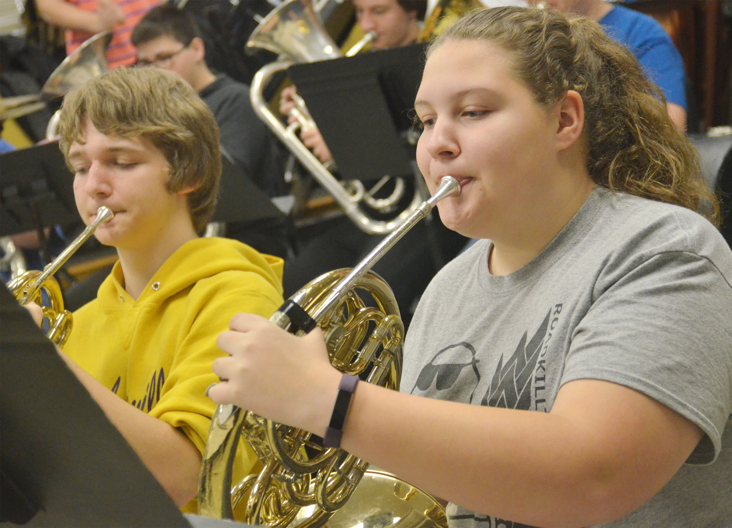 CHS freshmen Tristin Lopez, at left, and Abie Angel play the french horn.