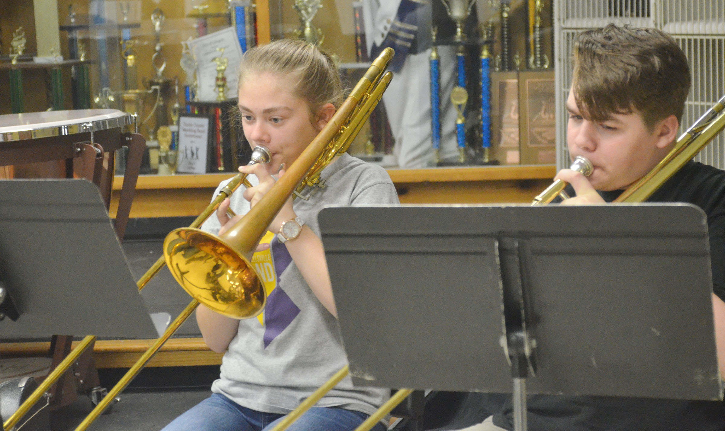 Campbellsville Middle School eighth-grader Emily Kerns, at left, and seventh-grader Austin Jeffries play trombone.