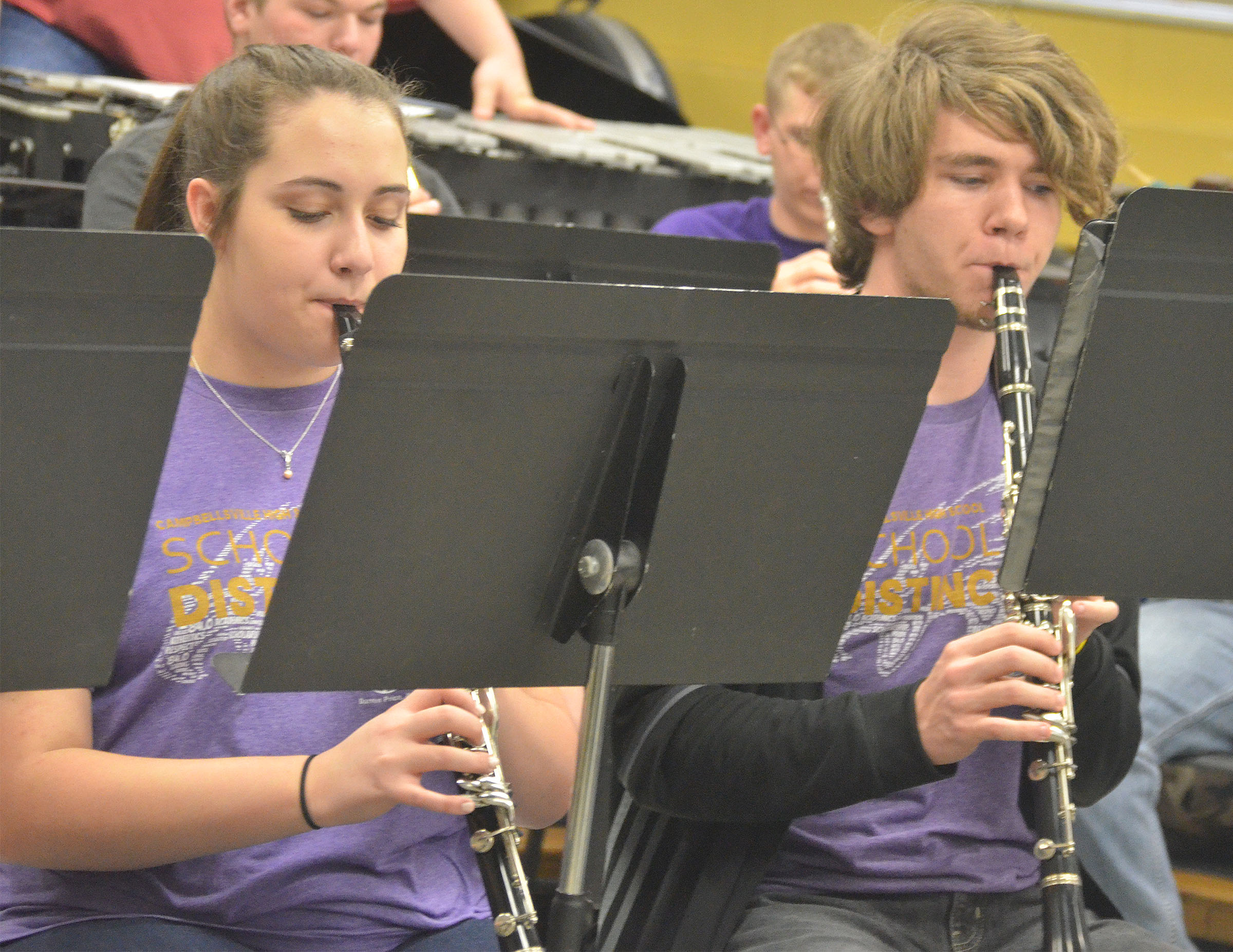 CHS sophomore Elizabeth Sullivan, at left, and junior Christian Berry play clarinet.