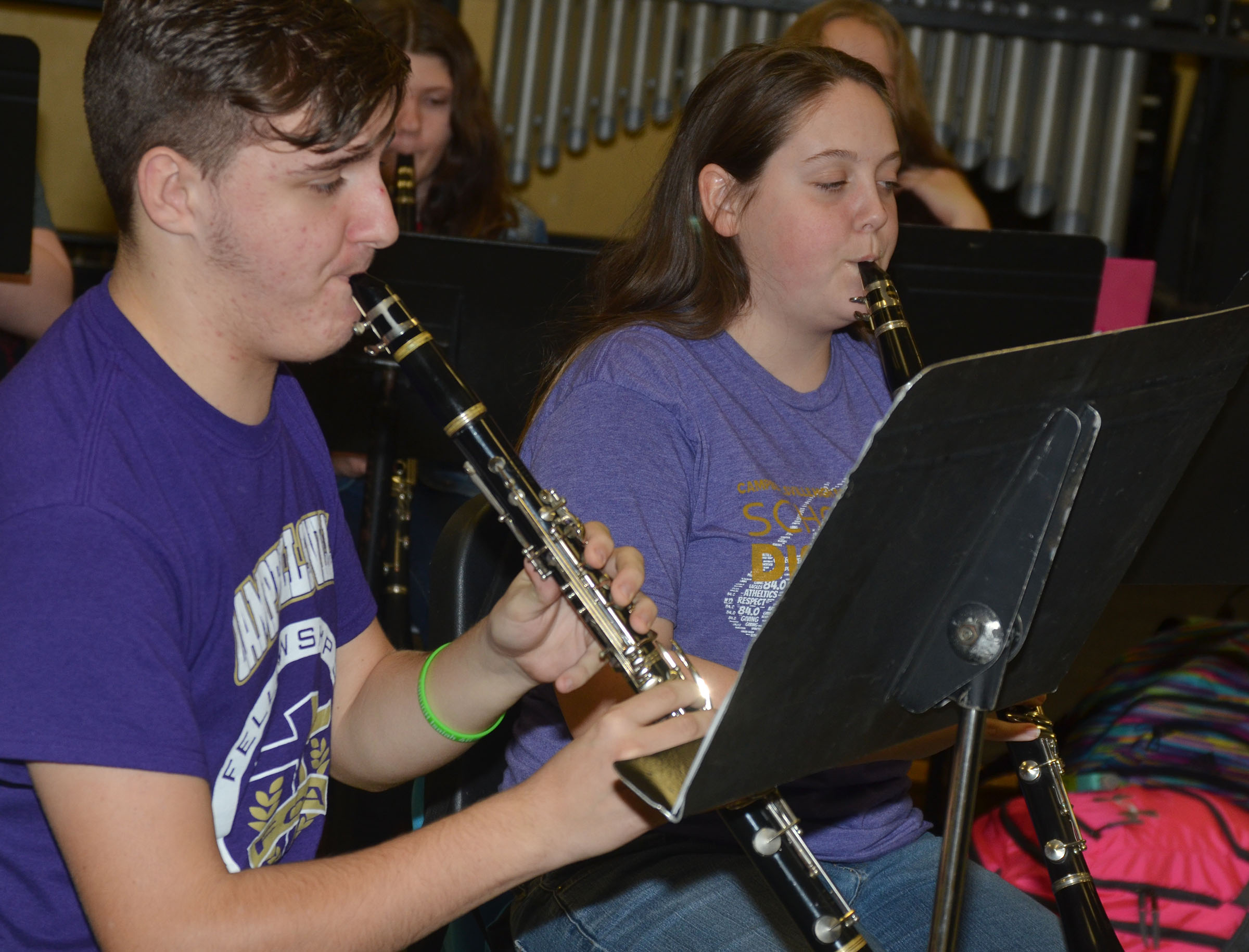 "CHS junior Austin Fitzgerald, at left, and sophomore Ruby Hatfield, clarinet players, practice ""Arrows."""