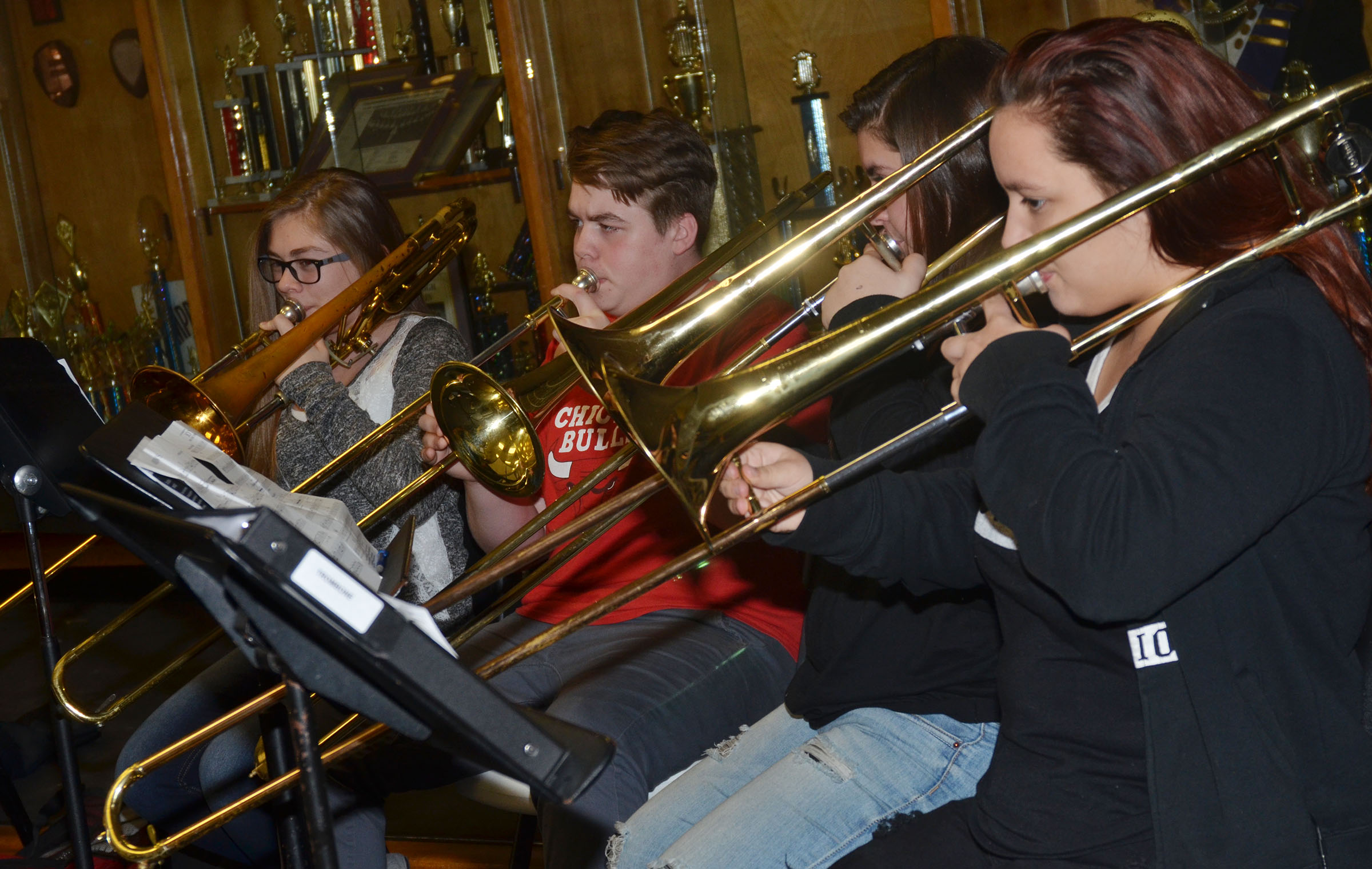 "From left, Campbellsville Middle School eighth-grader Emily Hayden, seventh-grader Austin Jeffries, freshman Brandy Miller and Autumn Babbs play ""Arrows"" on trombone."