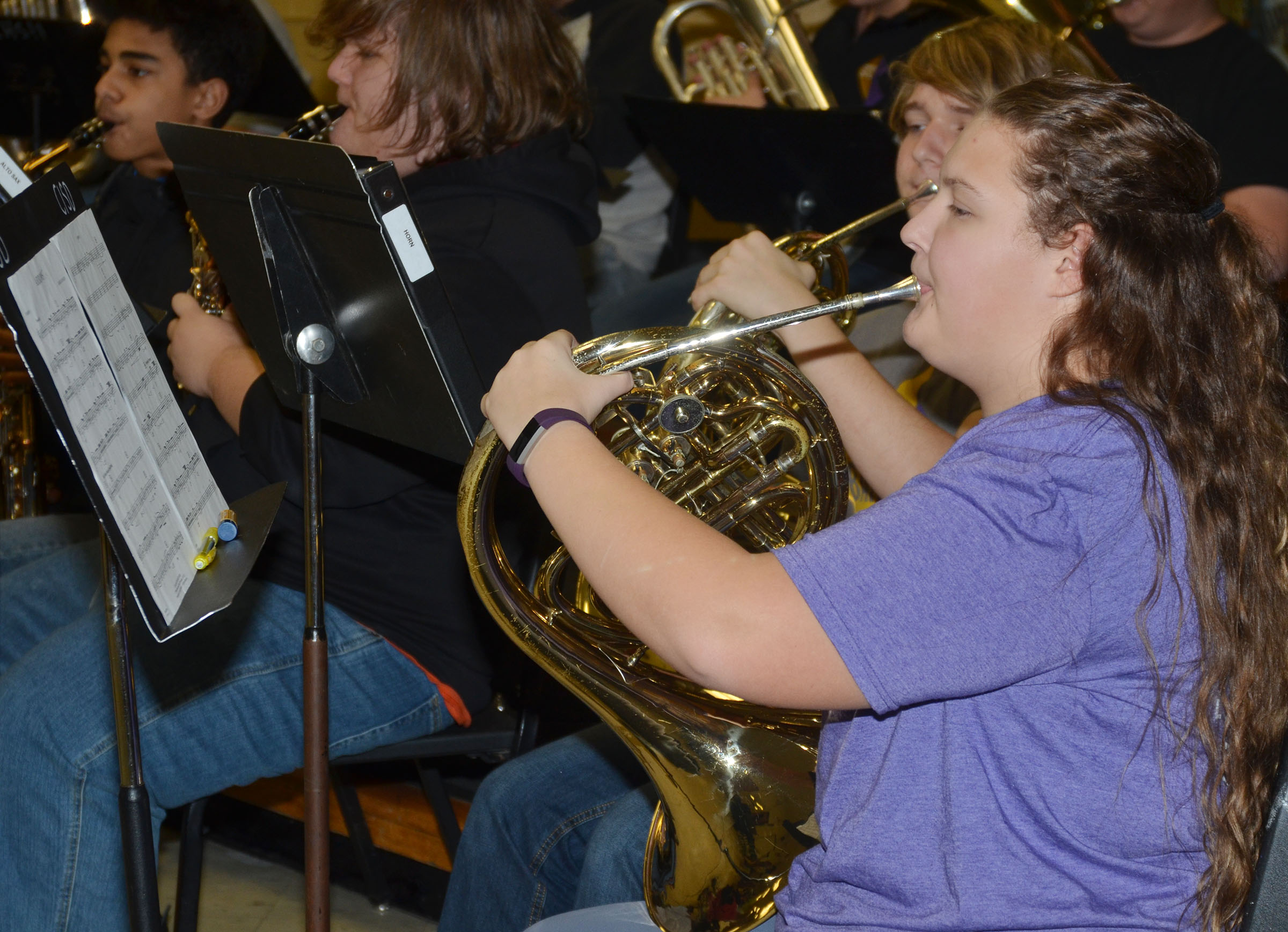 "CHS freshman Abie Angel plays ""Arrows"" on French horn."