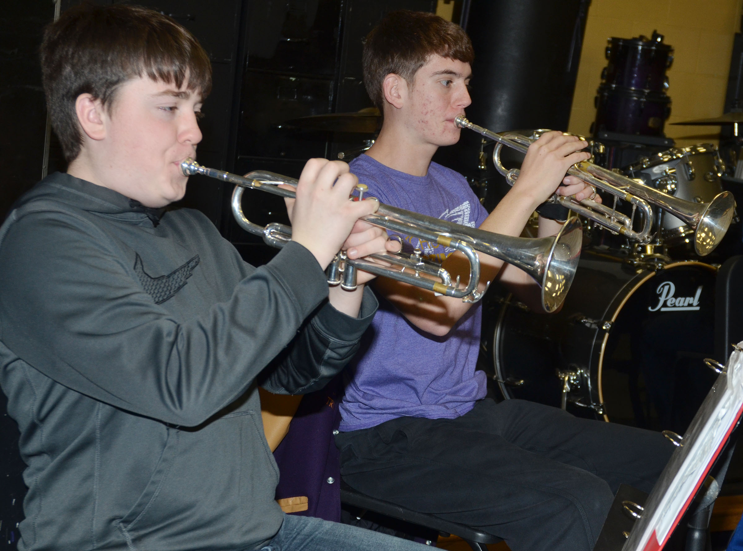 "CHS freshman Grant Rinehart, at left, and senior Murphy Lamb practice ""Arrows"" on trumpet."