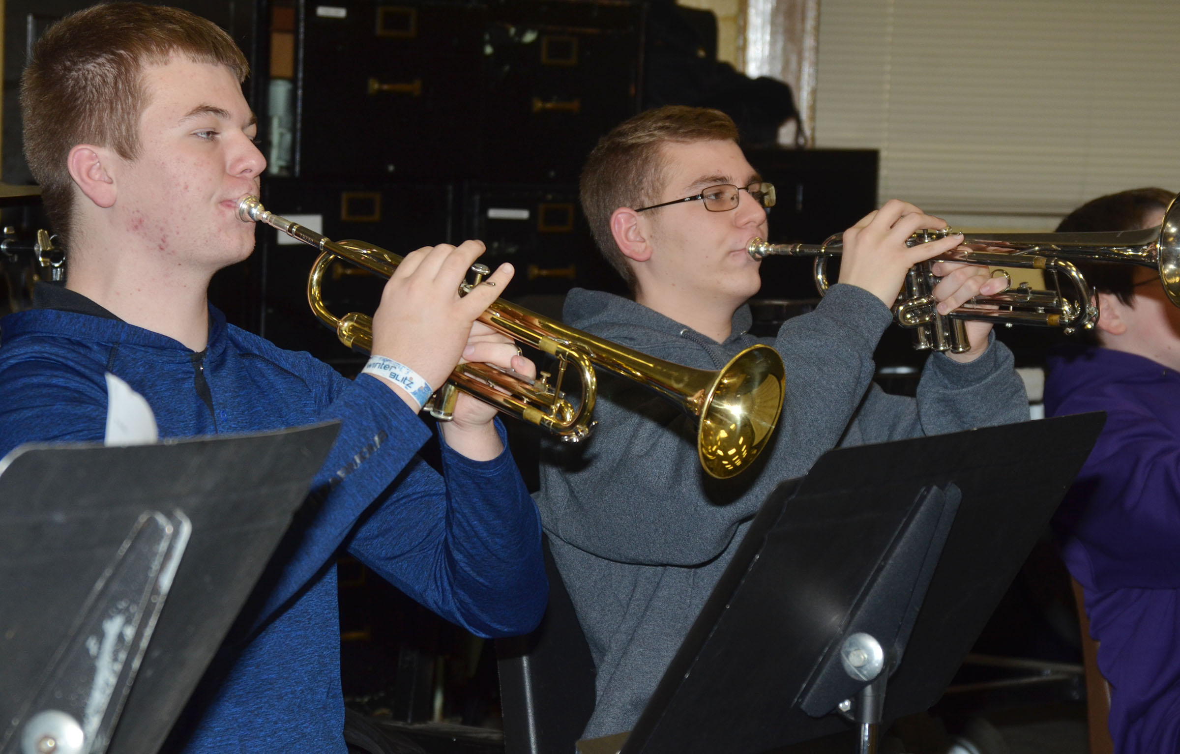 "CHS sophomores Josh Dooley, at left, and Brandon Greer practice ""Arrows"" on trumpet."