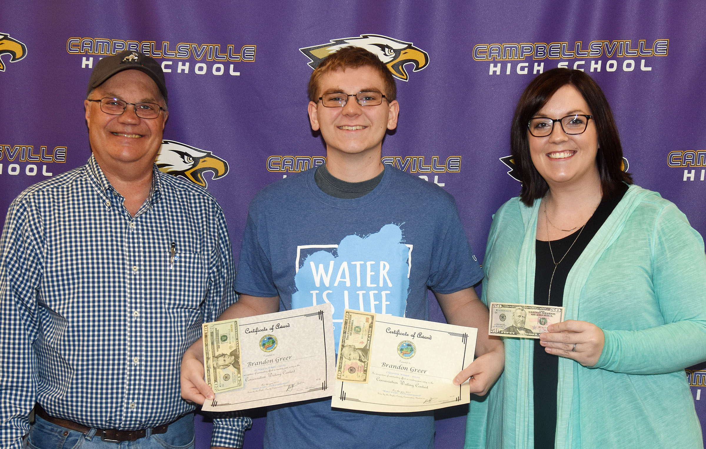 CHS junior Brandon Greer, center, won the Taylor County Conservation District writing contest for his school and received his $40 cash award from Taylor County Conservation District Board Member Barry Smith, at left. Greer's teacher Lindsay Williams won a $50 prize for classroom supplies.