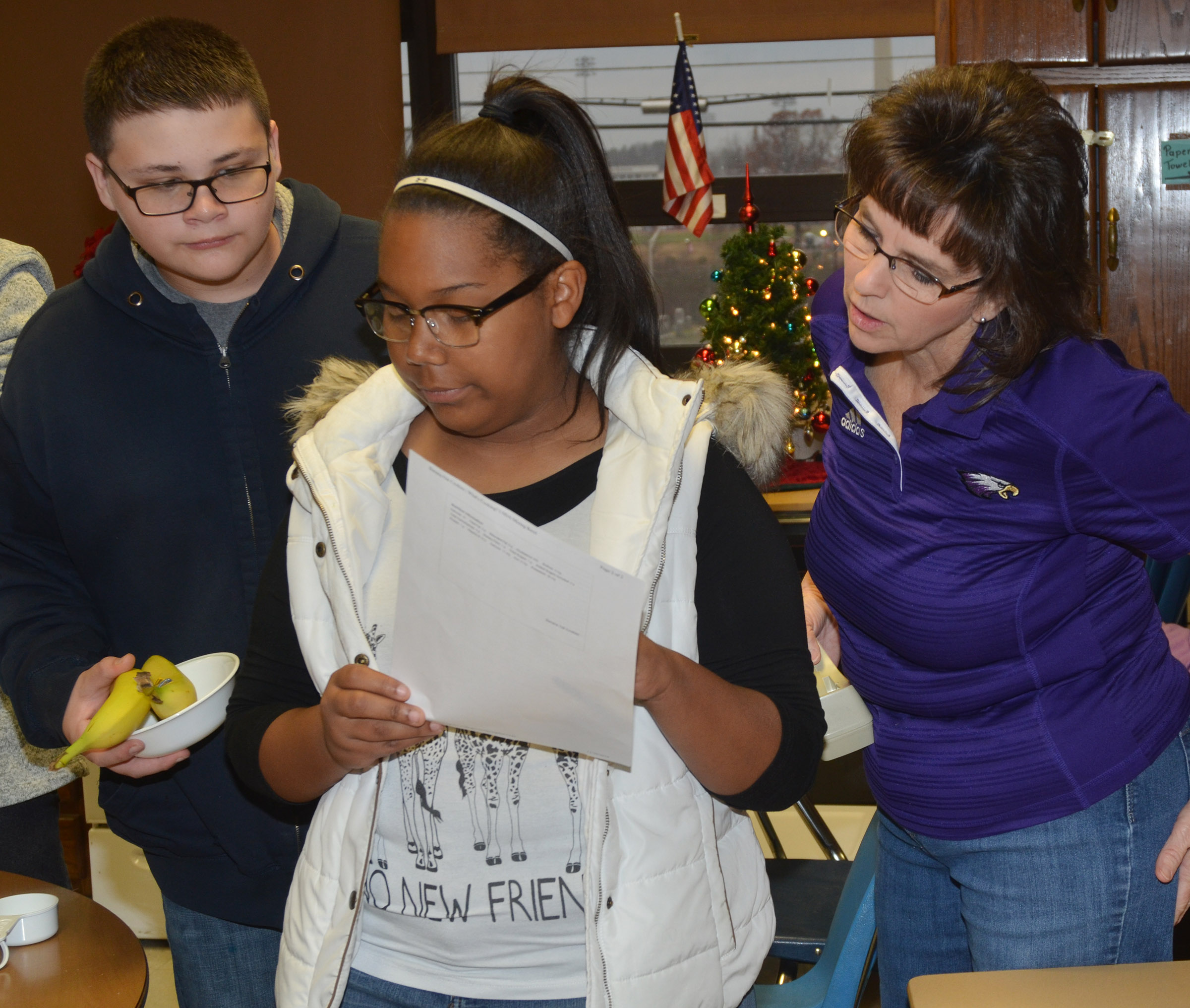 CHS teacher Deanna Campbell helps freshmen Gabriel Gutierrez and Zaria Cowan gather their ingredients.
