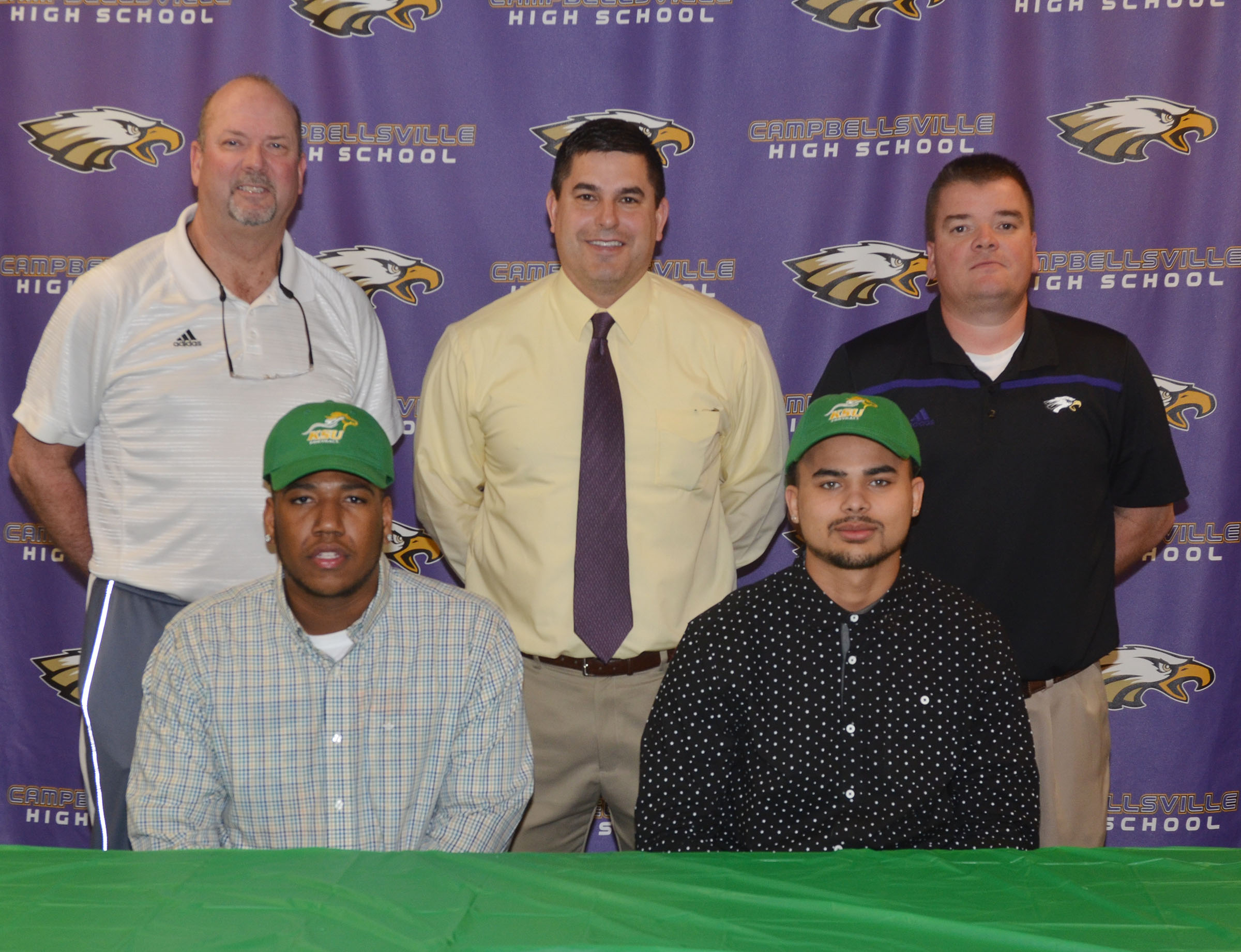 CHS seniors Micah Corley and Arick Groves will continue their academic and football careers at Kentucky State University this fall. The two signed their letters of intent in a special ceremony on Monday, Feb. 6. In front are Corley, at left, and Groves. In back, from left, are CHS Athletic Director Tim Davis, CHS Principal Kirby Smith and head football coach Dale Estes.