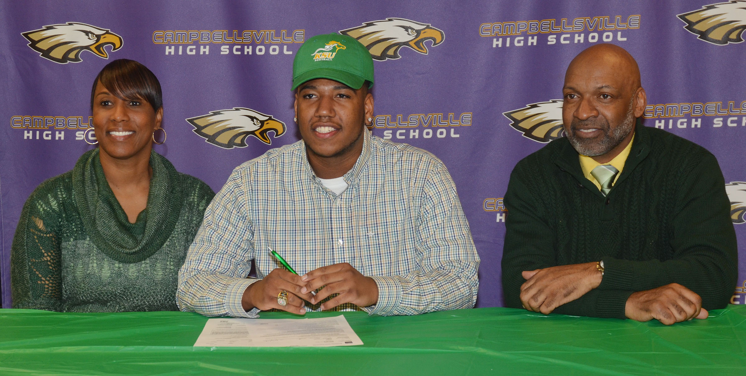 "CHS seniors Micah Corley and Arick Groves will continue their academic and football careers at Kentucky State University this fall. The two signed their letters of intent in a special ceremony on Monday, Feb. 6. Attending the ceremony with Corley, center, are his mother Latonya and stepfather Wilando ""Chop"" Bridgewater."