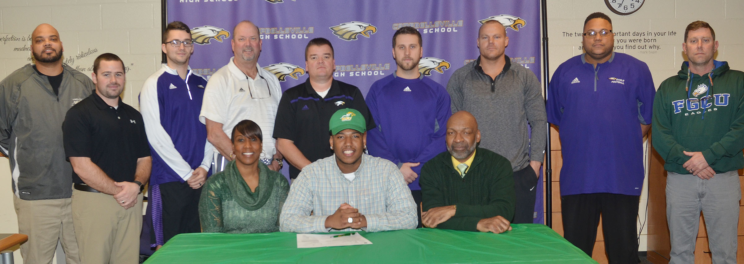 "CHS seniors Micah Corley and Arick Groves will continue their academic and football careers at Kentucky State University this fall. The two signed their letters of intent in a special ceremony on Monday, Feb. 6. Attending with Corley, front, center, are his mother Latonya Bridgewater and stepfather Wilando ""Chop"" Bridgewater. Back, CHS assistant football coaches Aaron Webb, Blake Milby and Cody Wills, CHS Athletic Director Tim Davis, head football coach Dale Estes and assistant football coaches Tyler Hardy, Robbie Gribbins, Bronson Gowdy and Herb Wiseman."