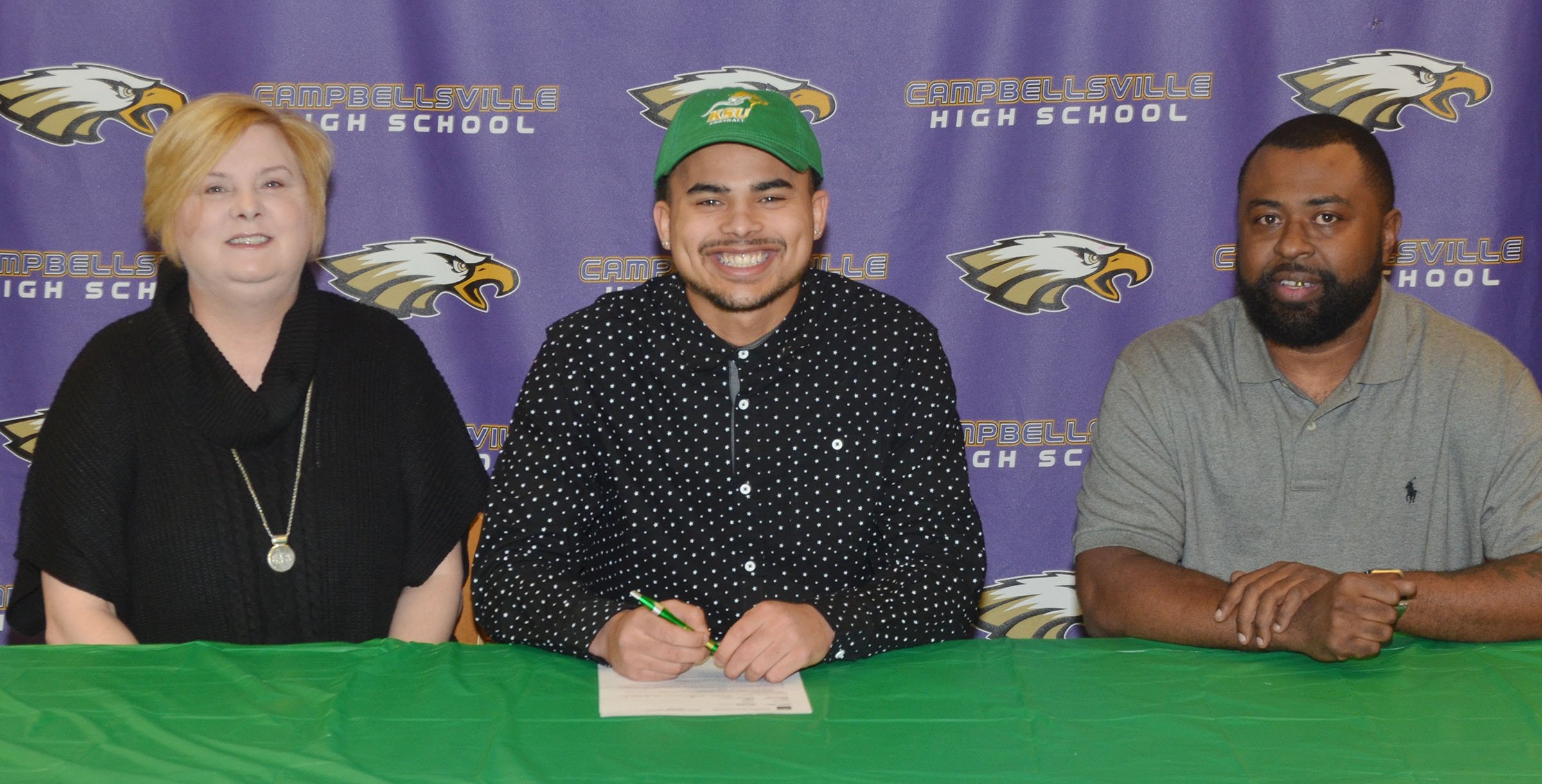 CHS seniors Micah Corley and Arick Groves will continue their academic and football careers at Kentucky State University this fall. The two signed their letters of intent in a special ceremony on Monday, Feb. 6. Pictured with Groves, center, are his mother Emily Farris and father Ty Groves.
