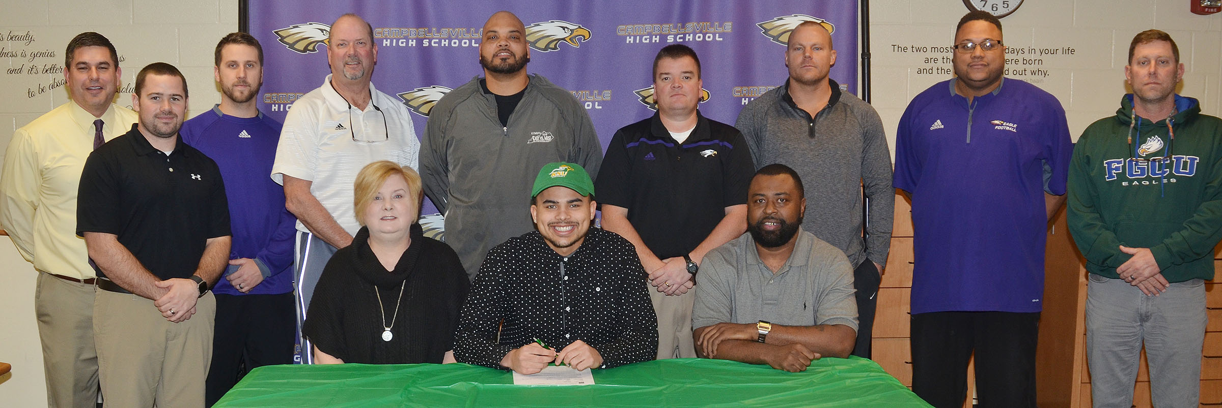 CHS seniors Micah Corley and Arick Groves will continue their academic and football careers at Kentucky State University this fall. The two signed their letters of intent in a special ceremony on Monday, Feb. 6. Pictured with Groves, front, center, are his mother Emily Farris and his father Ty Groves. Back, from left, CHS Principal Kirby Smith, assistant football coaches Blake Milby and Tyler Hardy, CHS Athletic Director Tim Davis, assistant football coach Aaron Webb, head football coach Dale Estes and assistant football coaches Robbie Gribbins, Bronson Gowdy and Herb Wiseman.