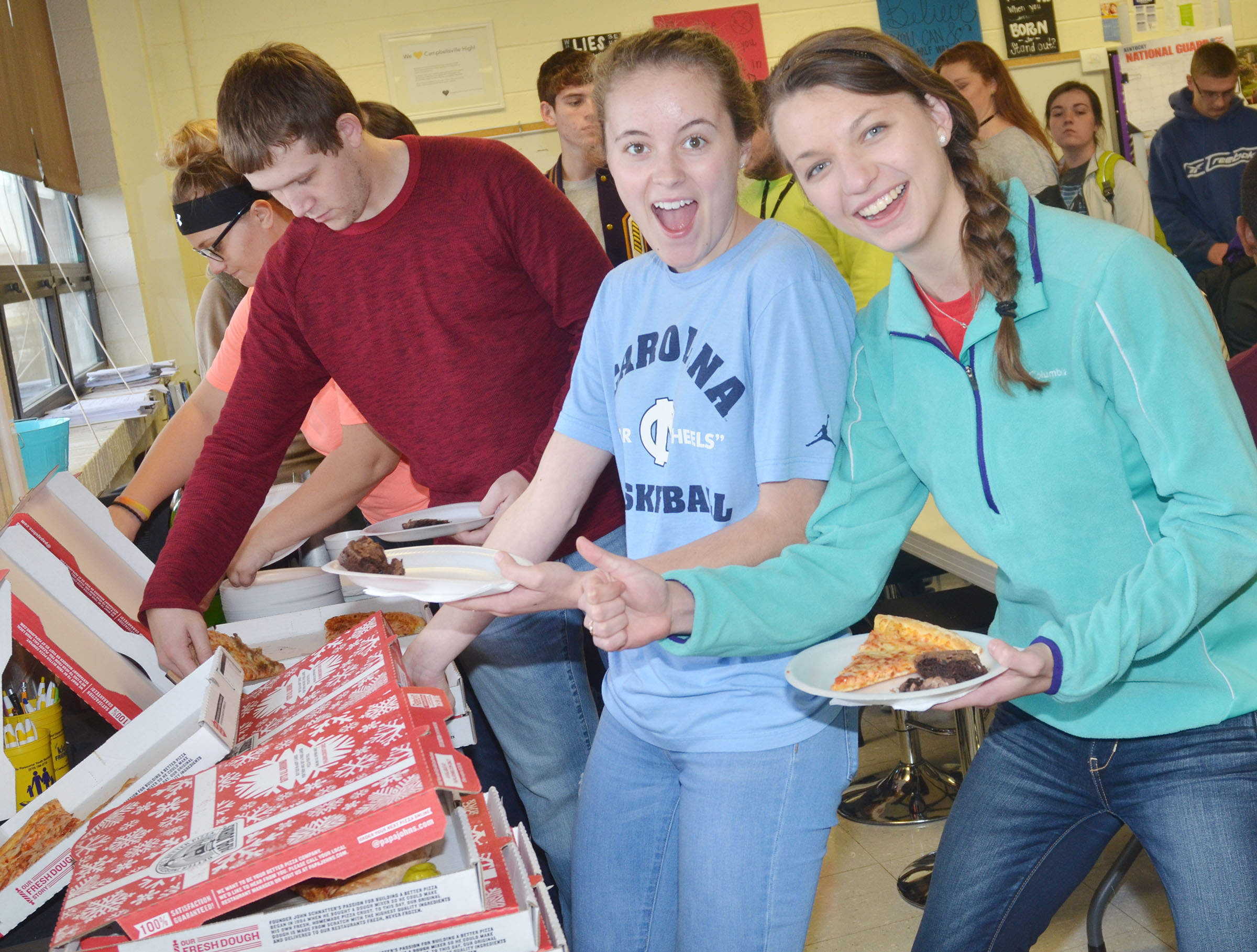 CHS seniors Caroline McMahan, at left, and Caylie Blair enjoy a pizza lunch.