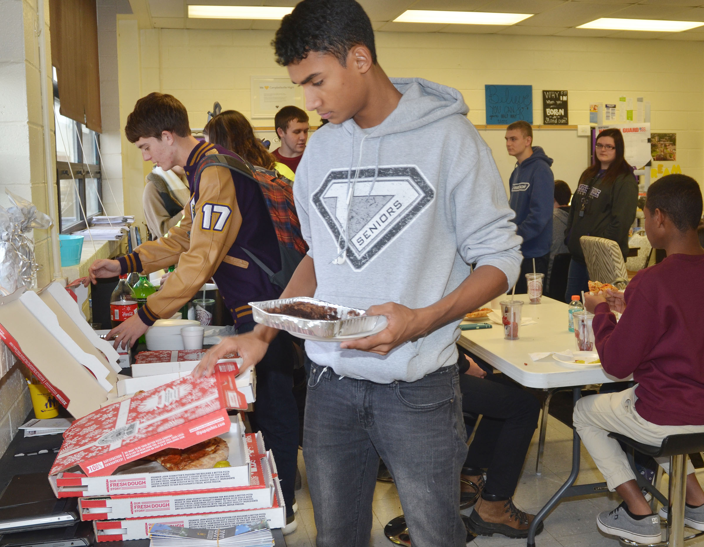 CHS senior Daniel Silva enjoys a pizza lunch.