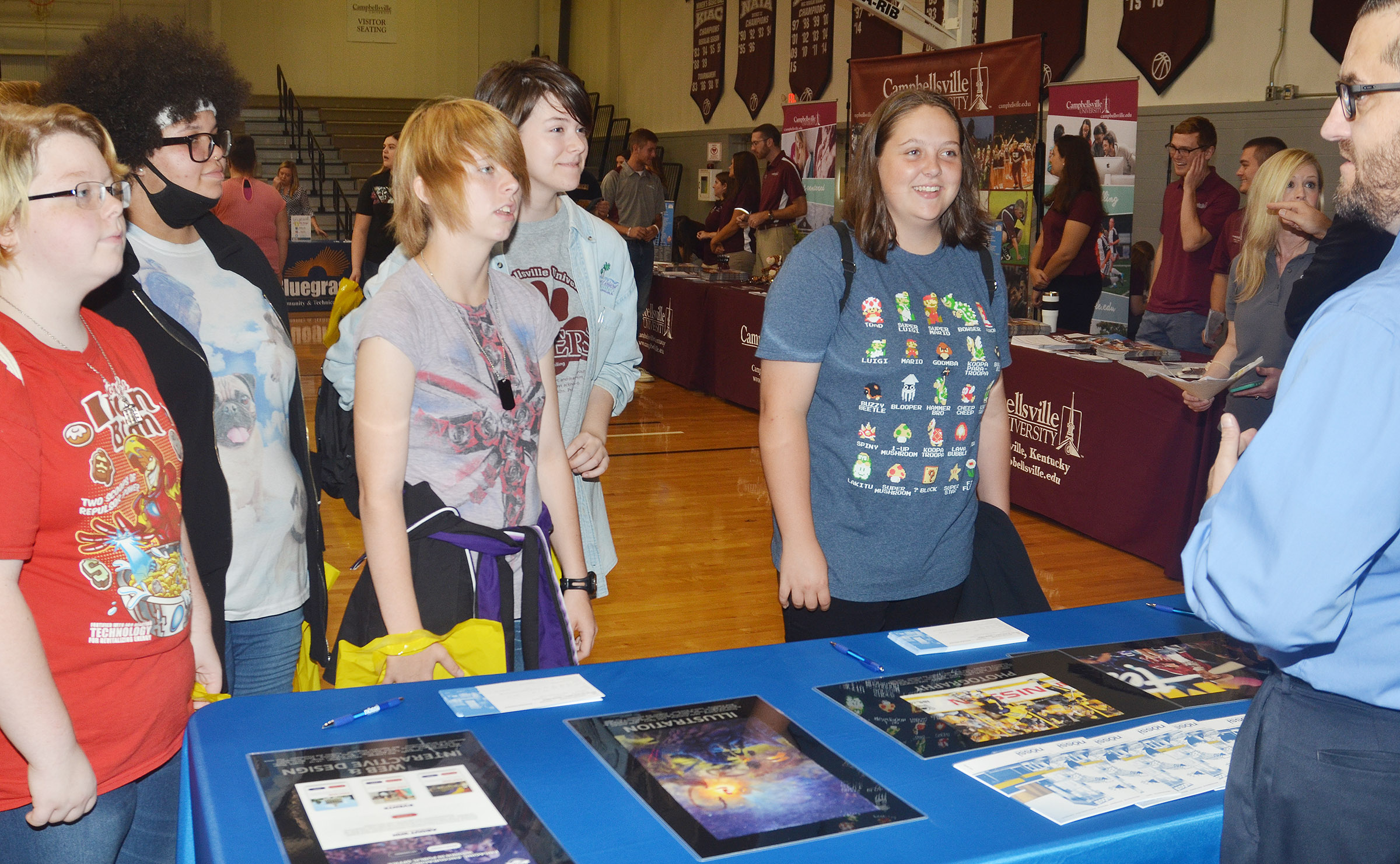 From left, CHS juniors Jessie Bennett, Jaylah Tucker, Christina Phipps, Chloe Decker and Ruby Hatfield learn about Nossi College of Art.